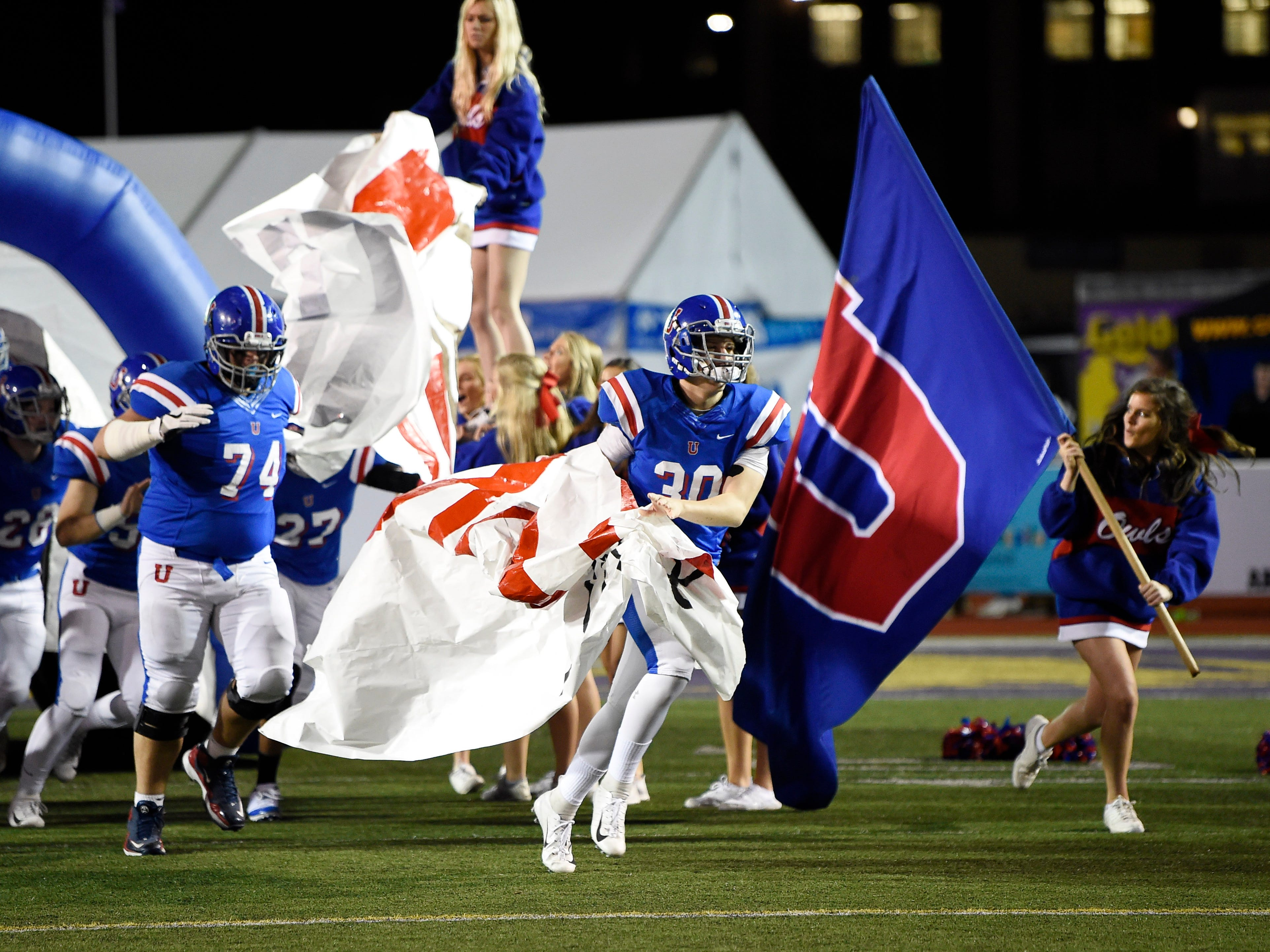 MUS players take the field for the Division II-AAA BlueCross Bowl state championship at Tennessee Tech's Tucker Stadium in Cookeville, Tenn., on Friday, Nov. 30, 2018.