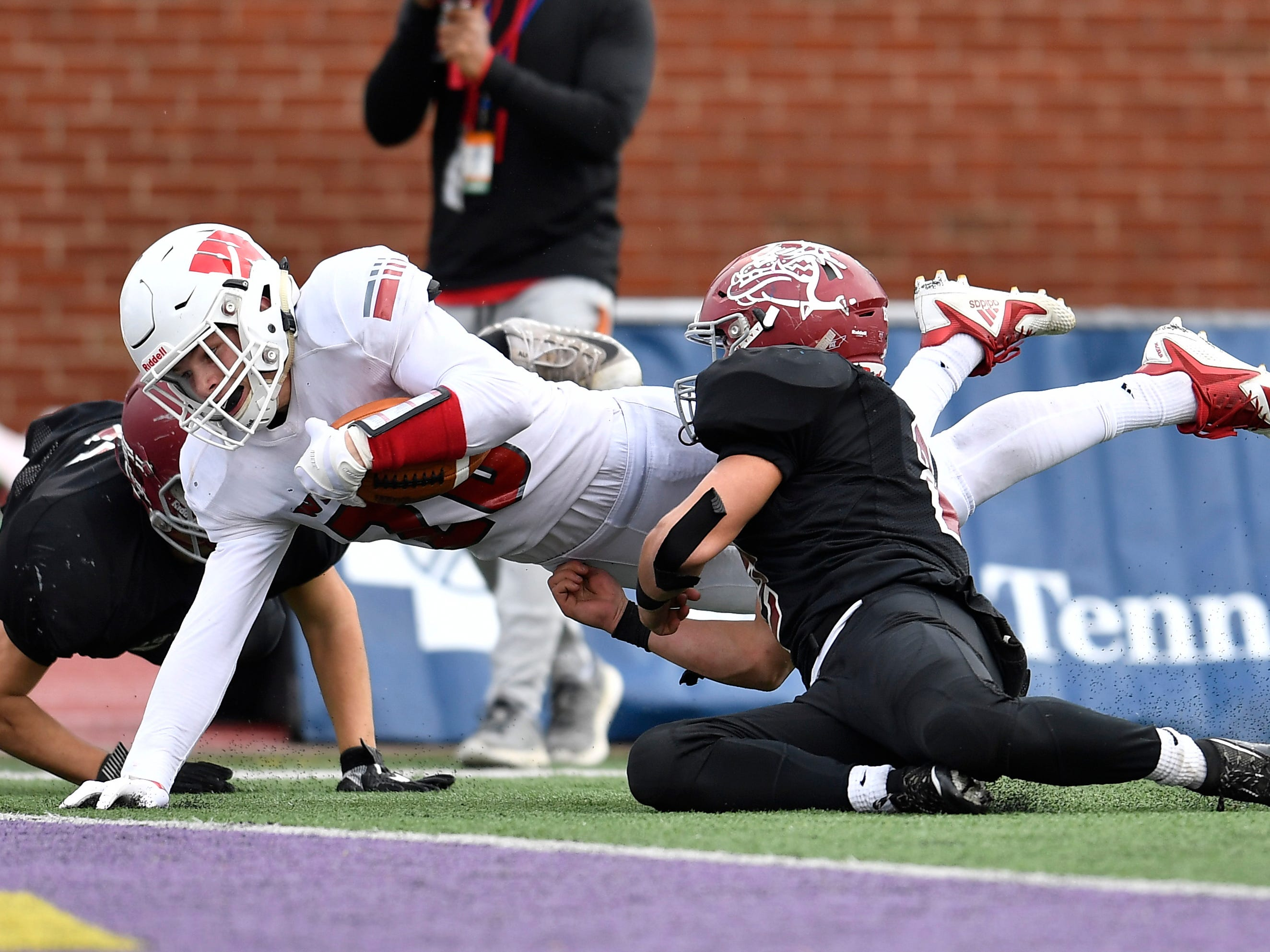 Whitwell wide receiver Tanner Stewart (20) dives in for a touchdown in the fourth quarter at the Class I-A BlueCross Bowl state championship at Tennessee Tech's Tucker Stadium in Cookeville, Tenn., on Saturday, Dec. 1, 2018.