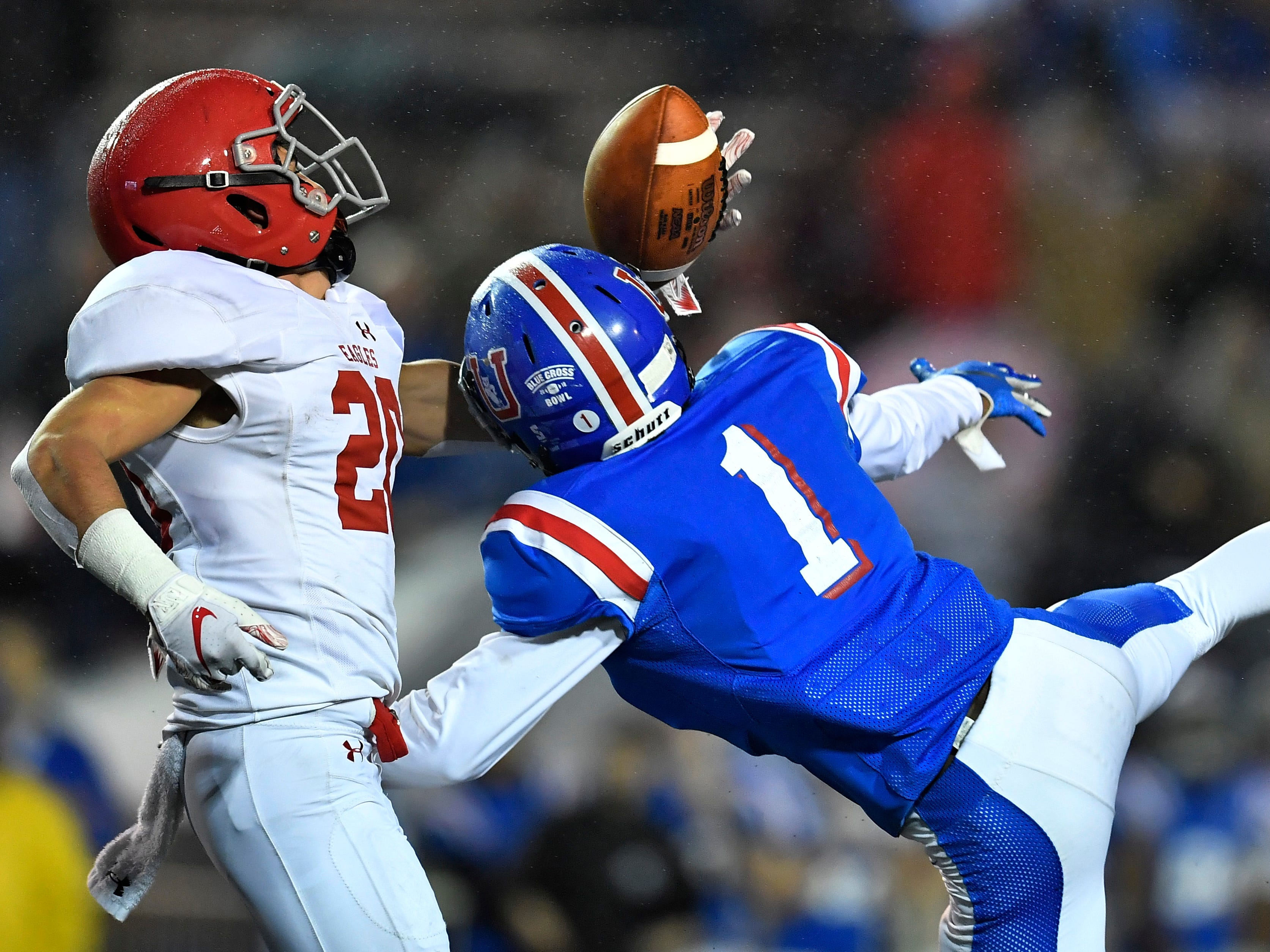 Brentwood Acad. wide receiver Preston Sagan (20) pulls in a touchdown catch defended by Memphis Univ. School defensive back Dekari Scott (1) in the second quarter at the Division II-AAA BlueCross Bowl state championship at Tennessee Tech's Tucker Stadium in Cookeville, Tenn., on Friday, Nov. 30, 2018.