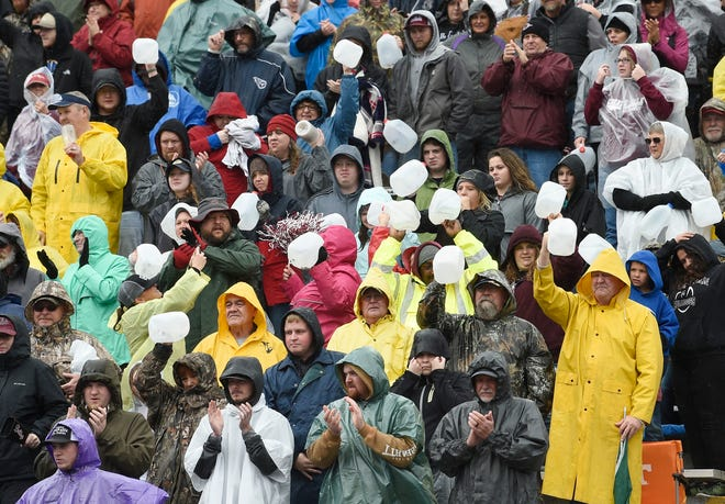Cornersville fans use jugs for noisemakers at the Class I-A BlueCross Bowl state championship at Tennessee Tech's Tucker Stadium in Cookeville, Tenn., on Saturday, Dec. 1, 2018.
