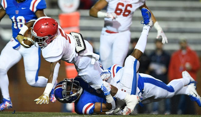 Memphis Univ. School wide receiver Dj Brown (36) stops Brentwood Academy running back Tomario Pleasant (5) in the first quarter at the Division II-AAA BlueCross Bowl state championship at Tennessee Tech's Tucker Stadium in Cookeville, Tenn., on Friday, Nov. 30, 2018.