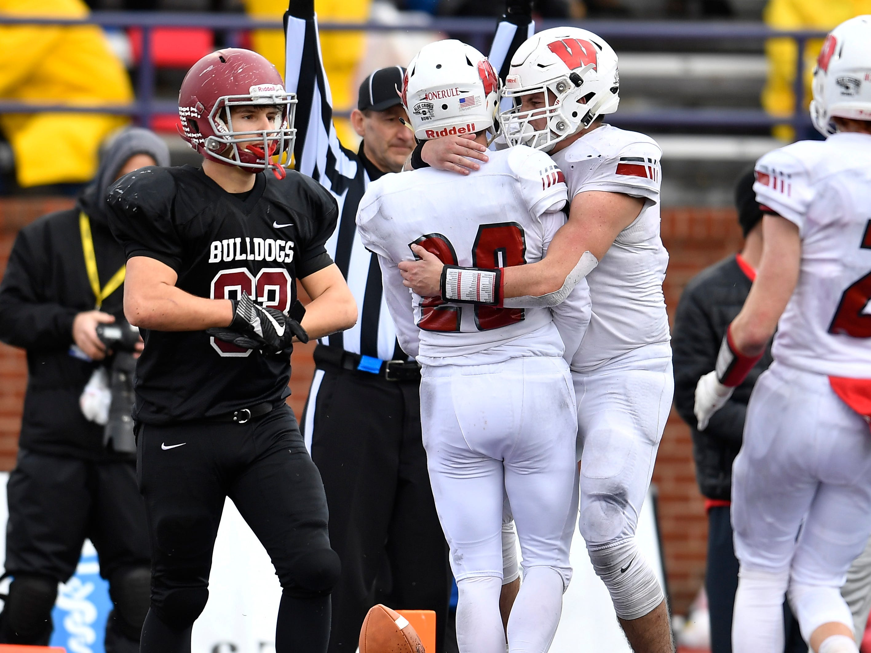 Whitwell wide receiver Tanner Stewart (20) is congratulated after his fourth-quarter touchdown in the Class I-A BlueCross Bowl state championship at Tennessee Tech's Tucker Stadium in Cookeville, Tenn., on Saturday, Dec. 1, 2018.