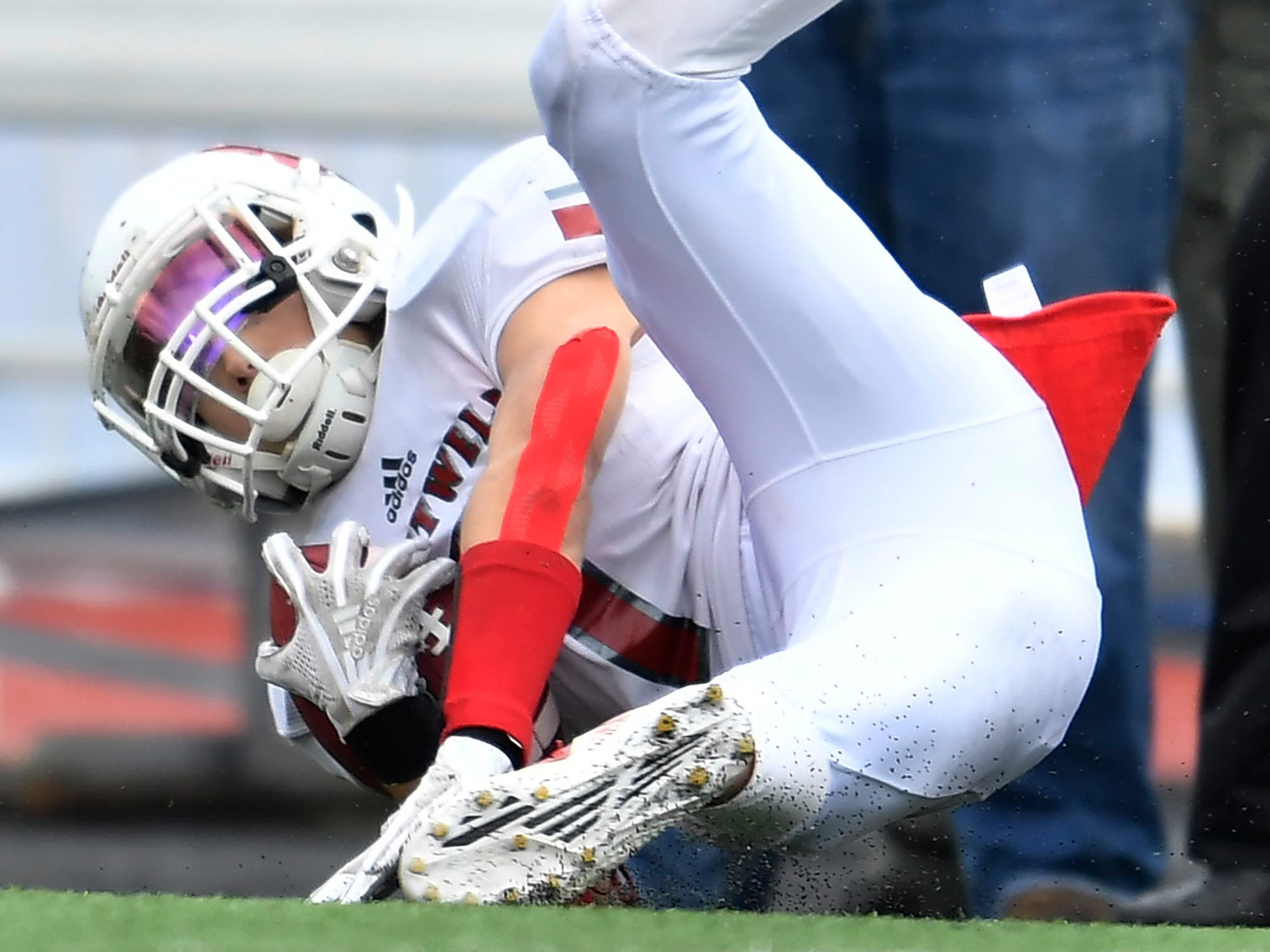 Whitwell defensive back Jaren Thames (7) pulls down an interception in the second quarter at the Class I-A BlueCross Bowl state championship at Tennessee Tech's Tucker Stadium in Cookeville, Tenn., on Saturday, Dec. 1, 2018.