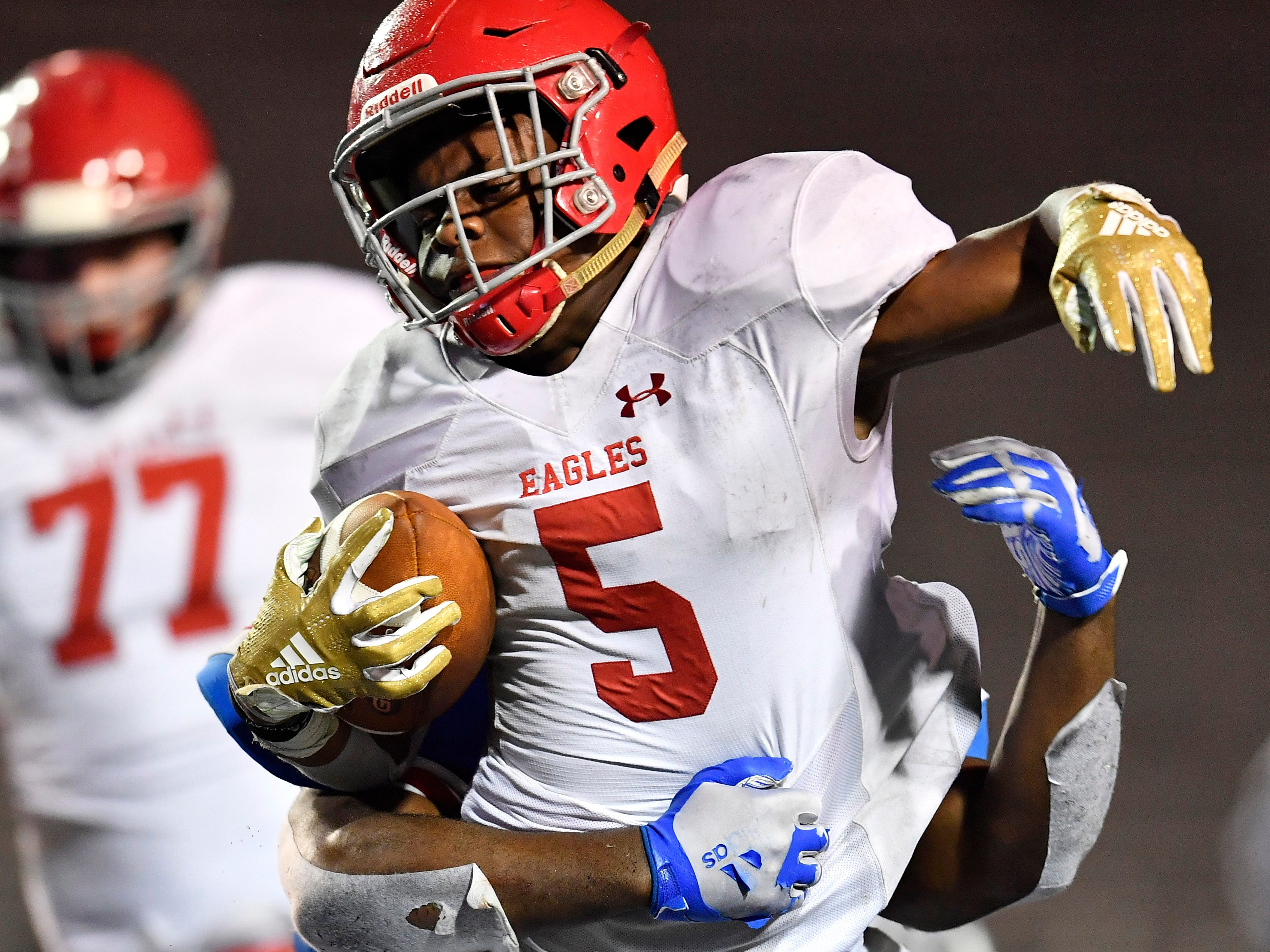 Brentwood Academy running back Tomario Pleasant (5) is brought down on a carry in the second quarter at the Division II-AAA BlueCross Bowl state championship at Tennessee Tech's Tucker Stadium in Cookeville, Tenn., on Friday, Nov. 30, 2018.