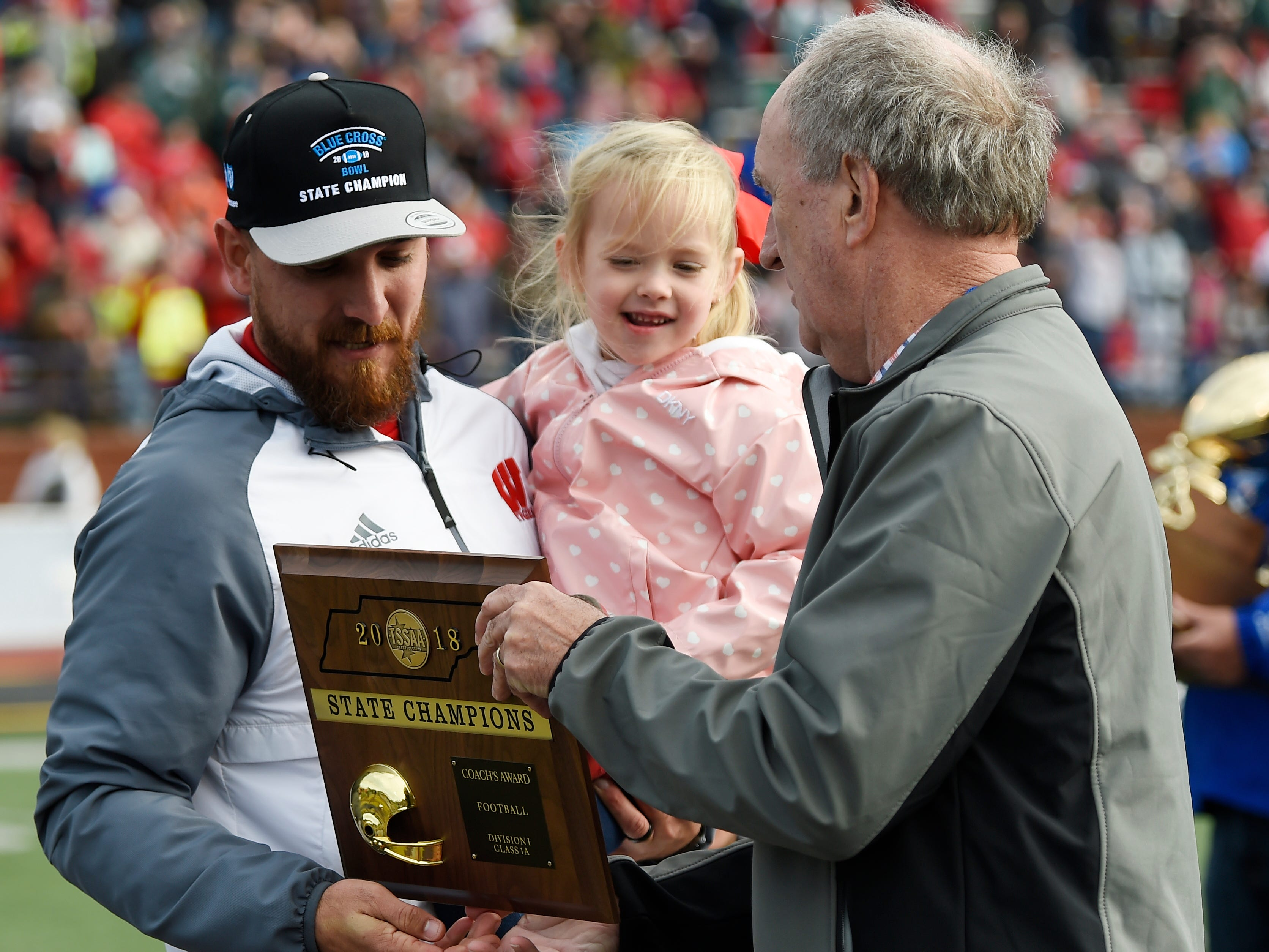 Whitwell head coach Randall Boldin accepts the championship trophy at the Class I-A BlueCross Bowl state championship at Tennessee Tech's Tucker Stadium in Cookeville, Tenn., on Saturday, Dec. 1, 2018.