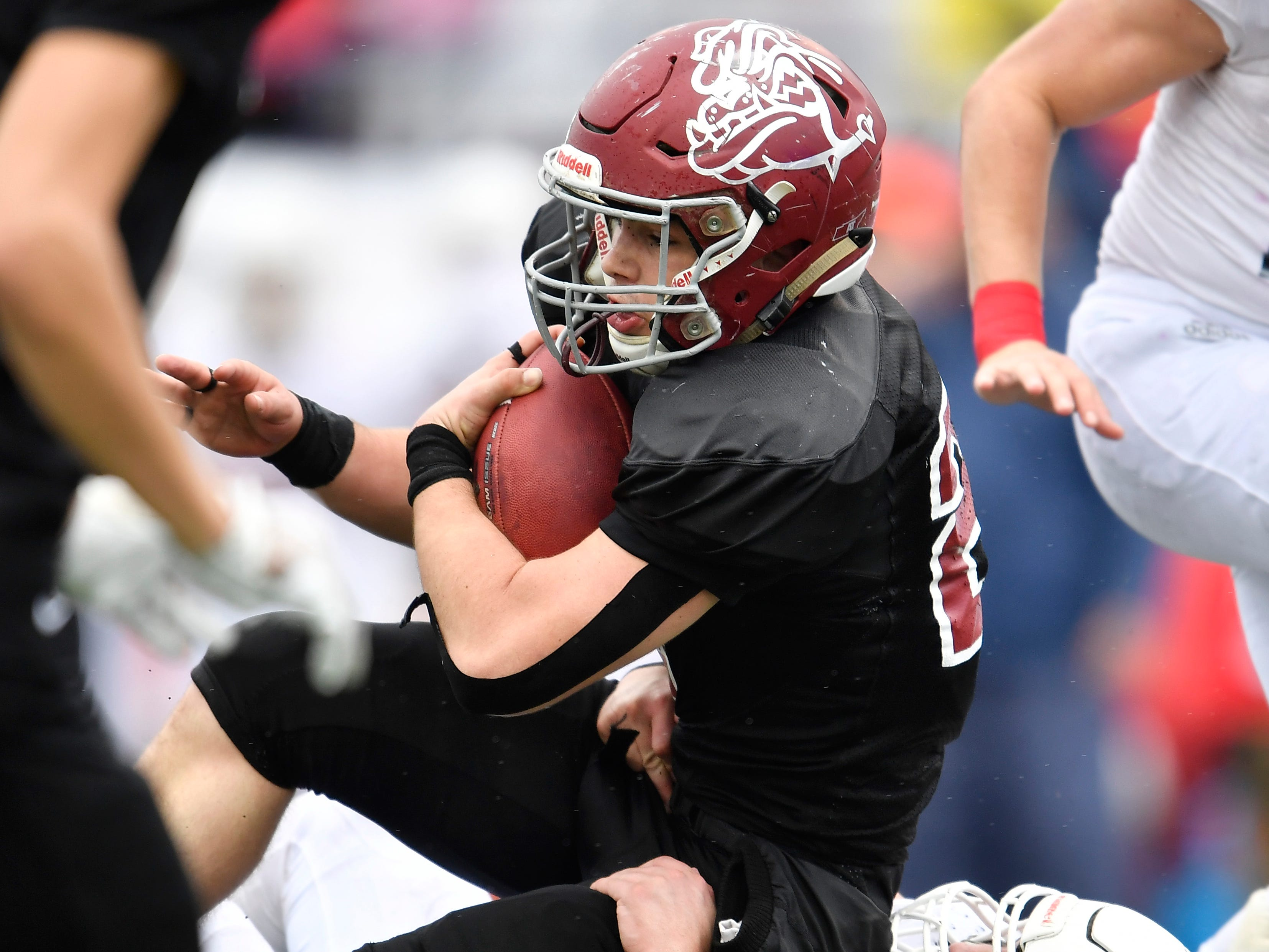 Cornersville's Eli Woodard (22) gets a first down in the second quarter at the Class I-A BlueCross Bowl state championship at Tennessee Tech's Tucker Stadium in Cookeville, Tenn., on Saturday, Dec. 1, 2018.