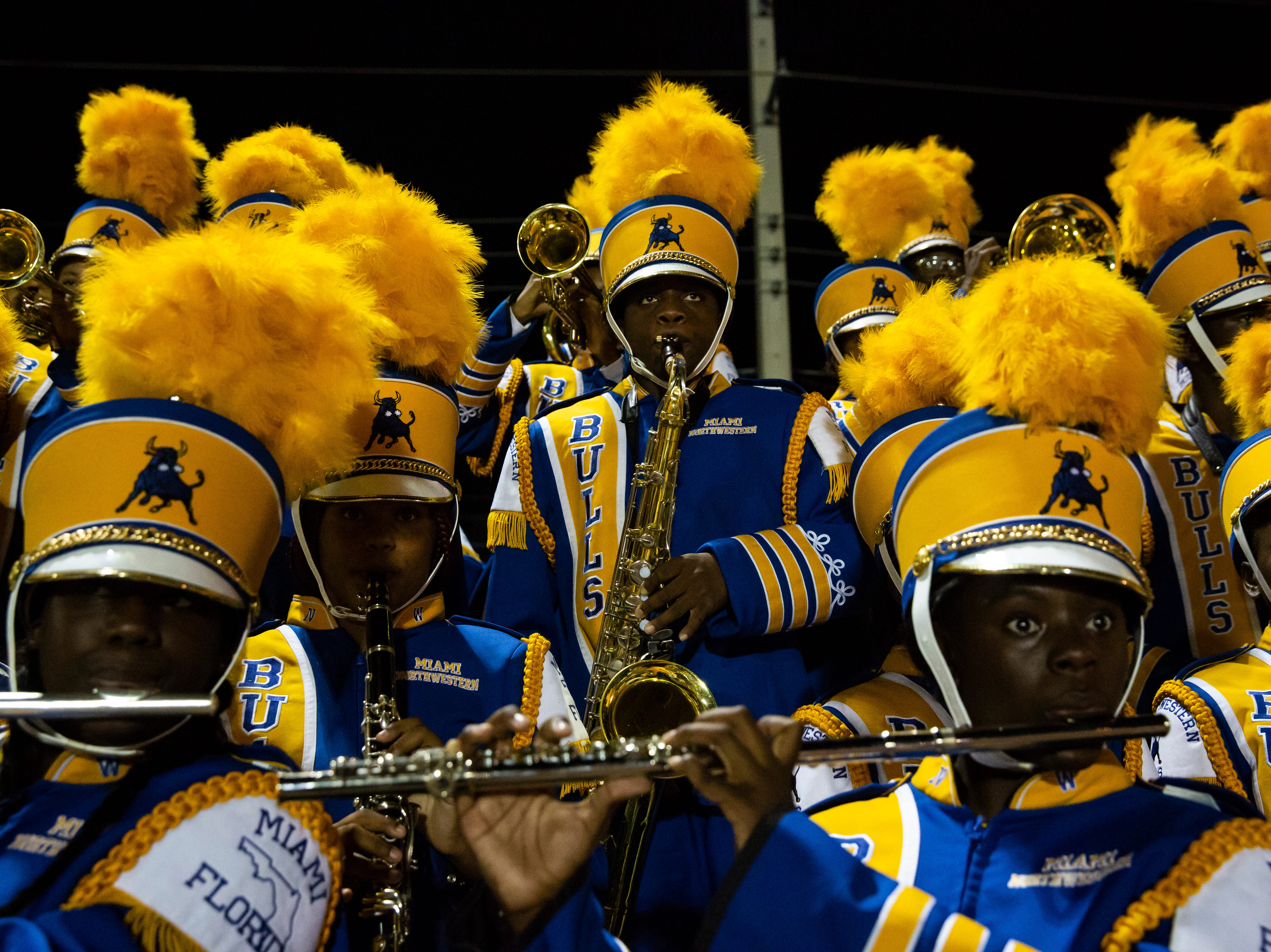 The Miami Northwestern Senior High marching band perform during the Class 6A state semifinals game on Friday, November 30, 2018, at Naples High School in Naples.