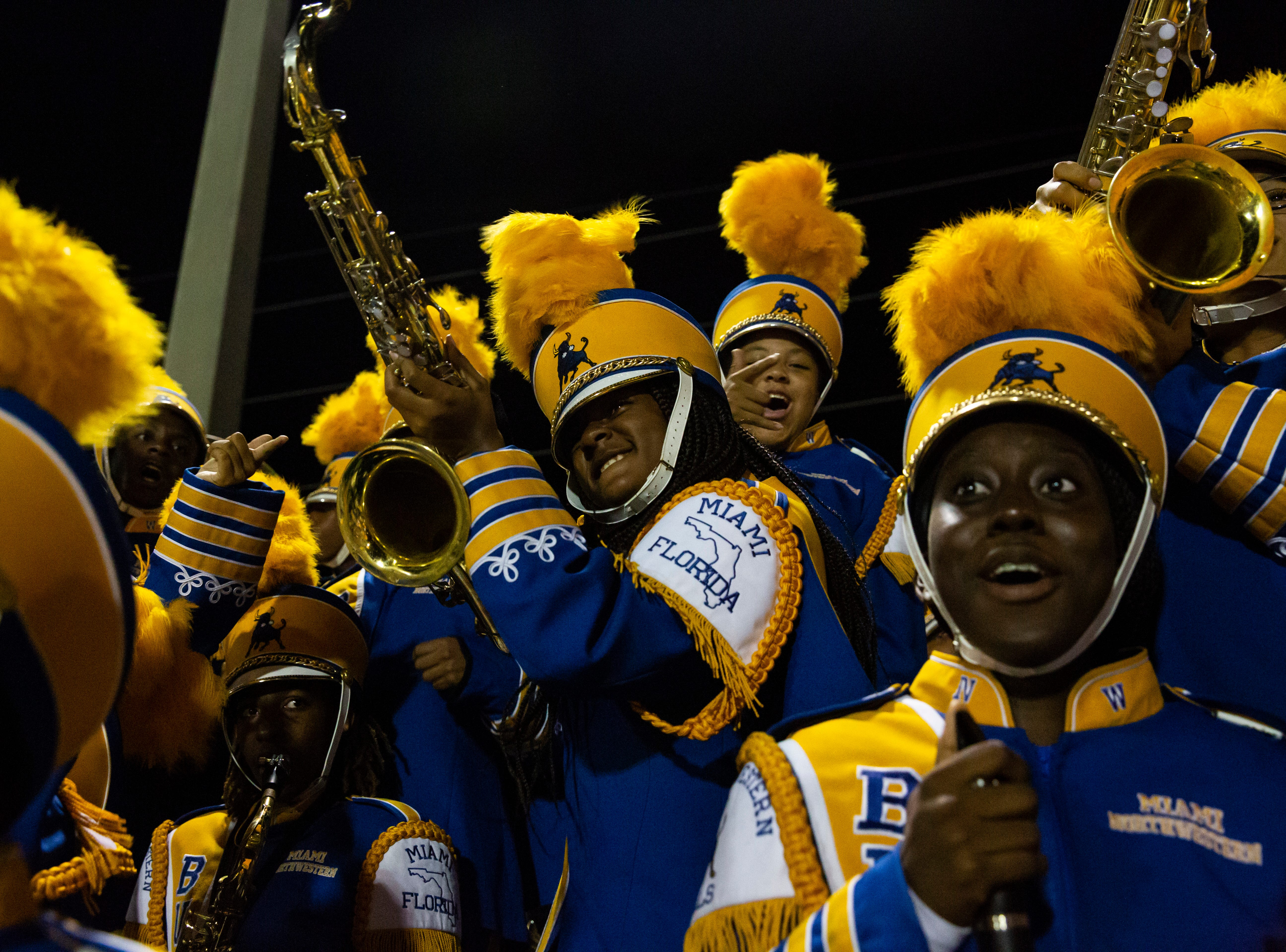 The Miami Northwestern Senior High marching band performer, Eunique Dozier, gets excited during the Class 6A state semifinals game against Naples High School on Friday, November 30, 2018, at Naples High School in Naples.
