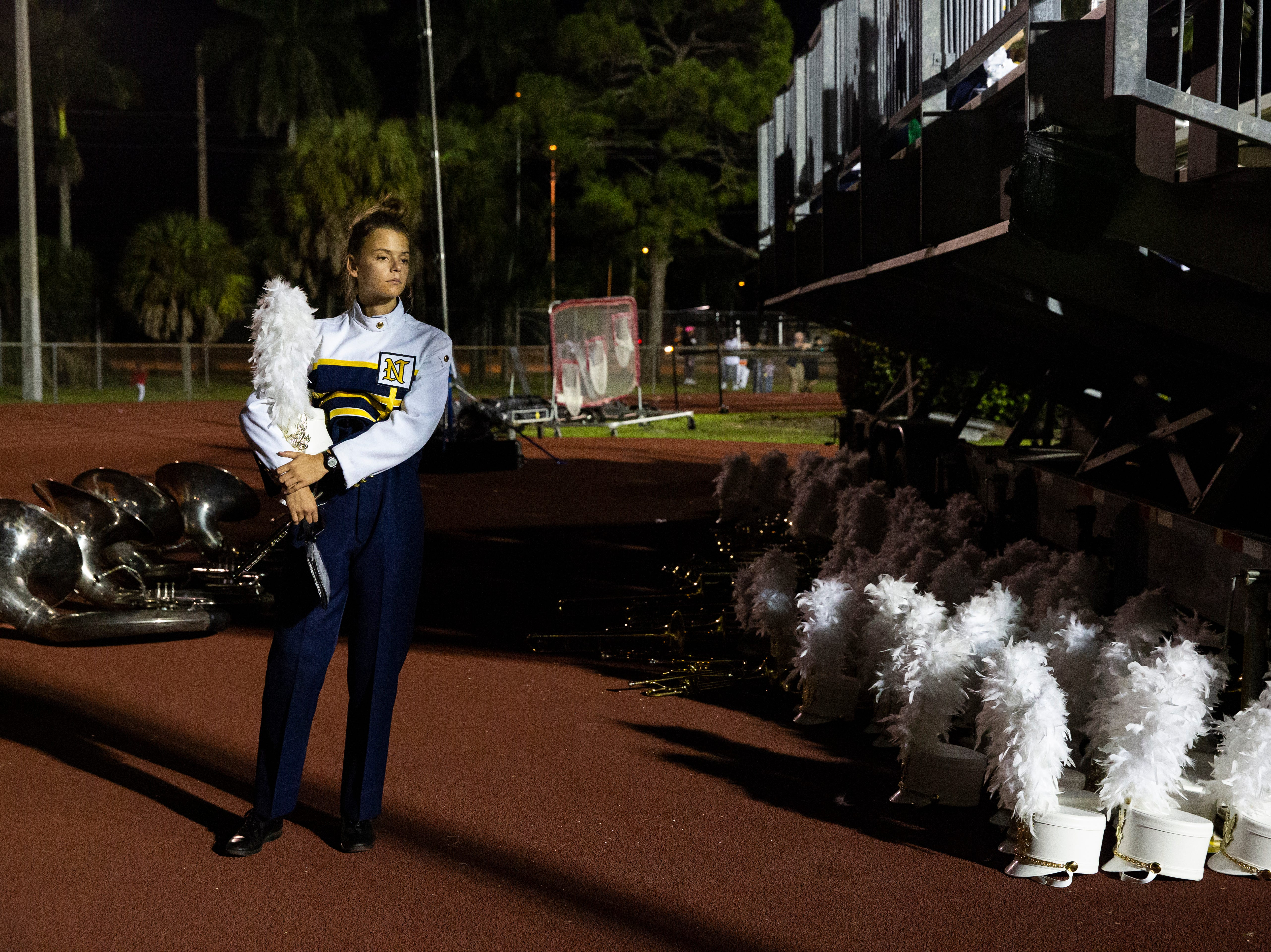 """Lydia Cartwright, 17, of the Naples High School marching band, stands quietly after their half-time performance. """"Hopefully we can finish strong,"""" Cartwright said. The Naples High School lost the Class 6A state semifinals against Miami-Northwestern Senior High Friday evening, November 30, 2018, at Naples High School in Naples."""