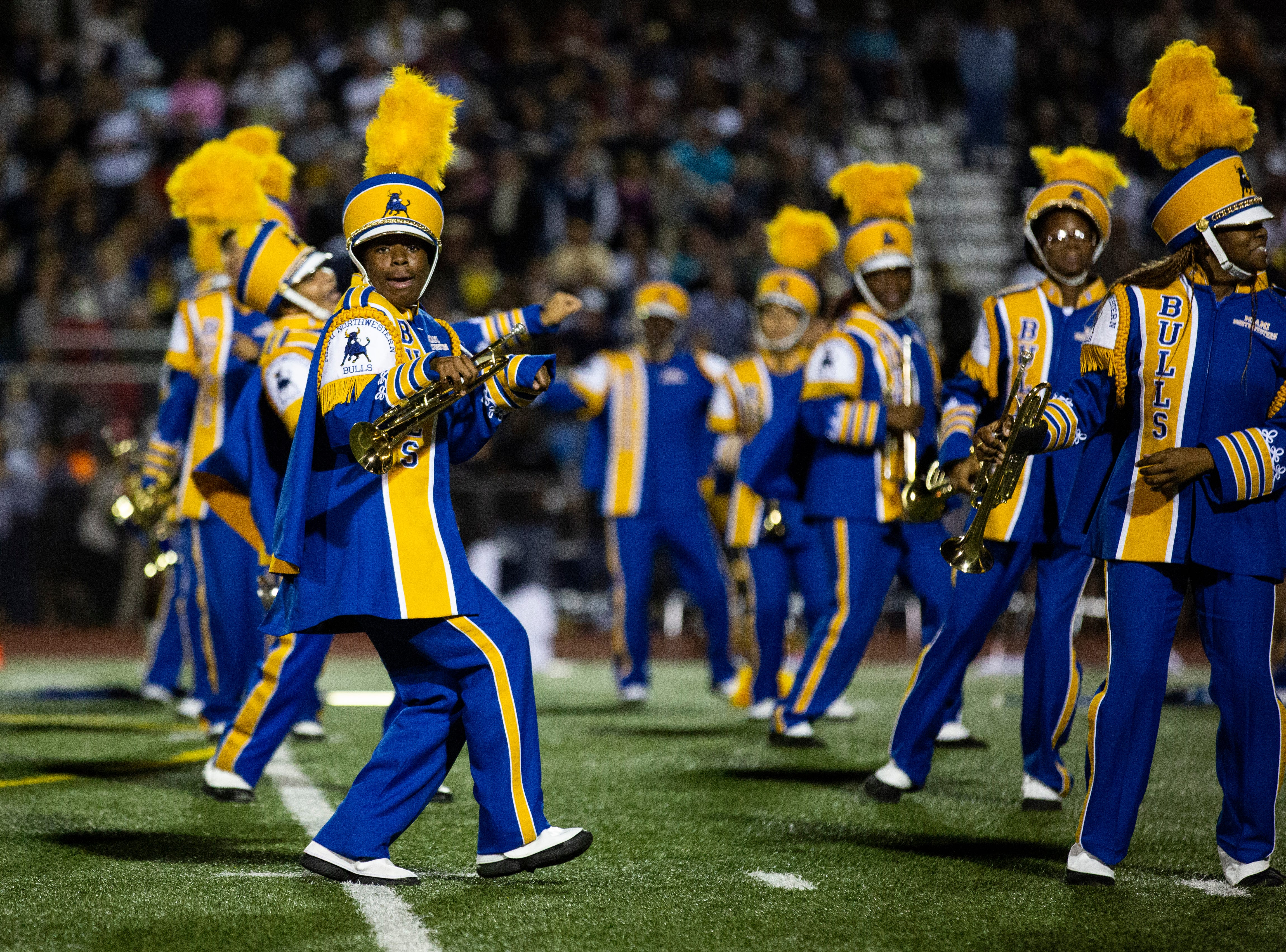 The Miami Northwestern Senior High marching band performs during the halftime at the Class 6A state semifinals game on Friday, November 30, 2018, at Naples High School in Naples.