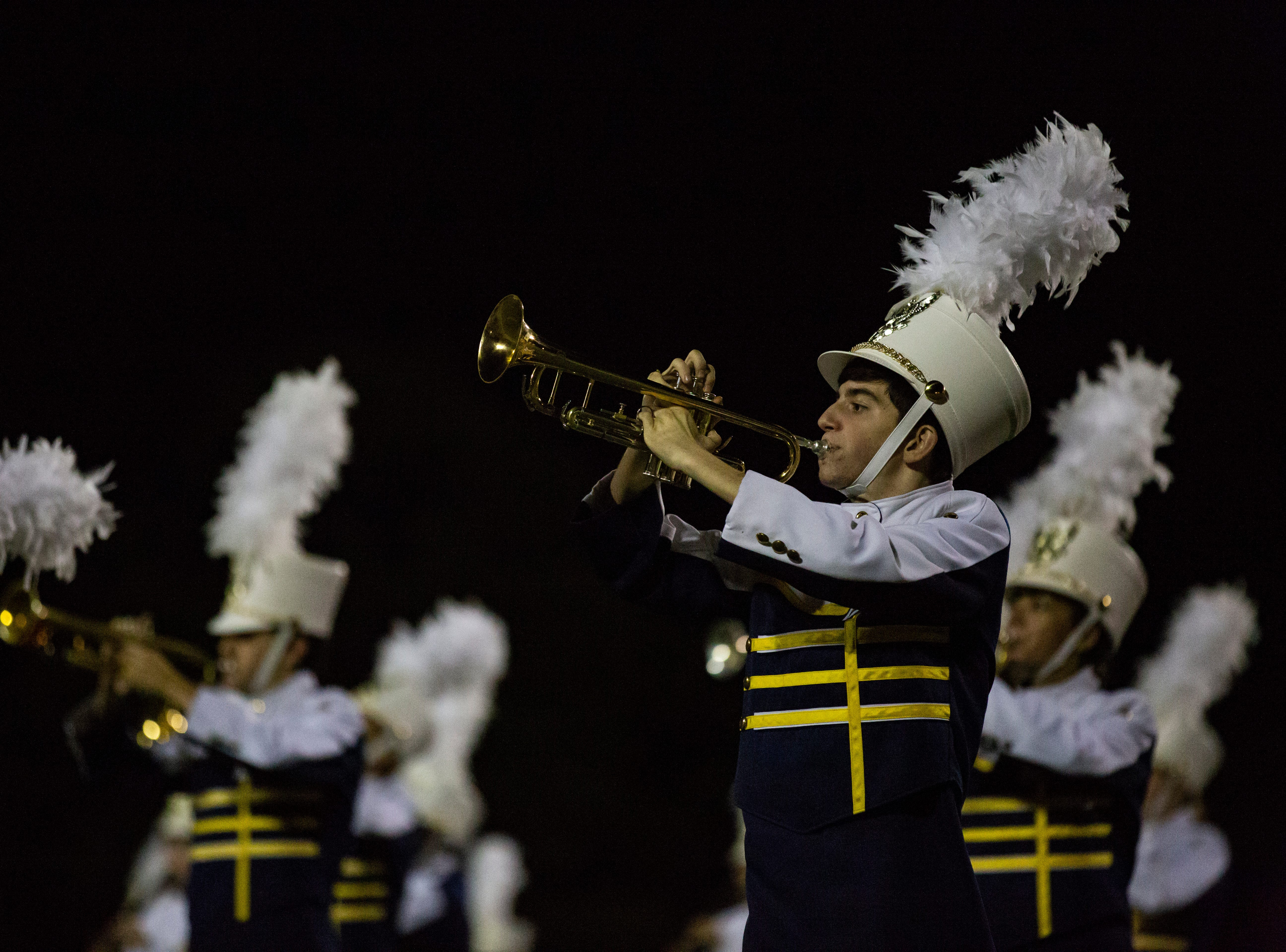 The Naples High School marching band performs during the halftime at the Class 6A state semifinals game on Friday, November 30, 2018, at Naples High School in Naples.