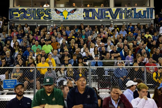 The Naples High School crowd sits solemnly during the third quarter as Miami-Northwestern Senior High dominates the scoreboard during the Class 6A state semifinal game Friday at Staver Field.