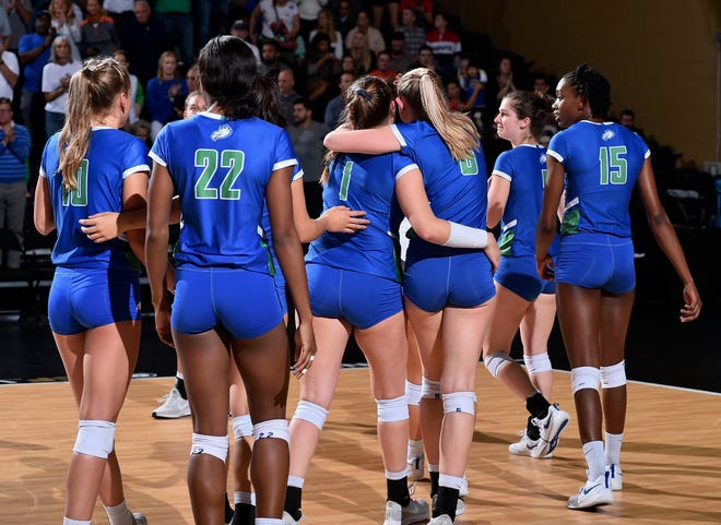 The Florida Gulf Coast University volleyball team walks off the court after being swept by Florida, 3-0, in the second round of the NCAA tournament in Orlando on Friday.