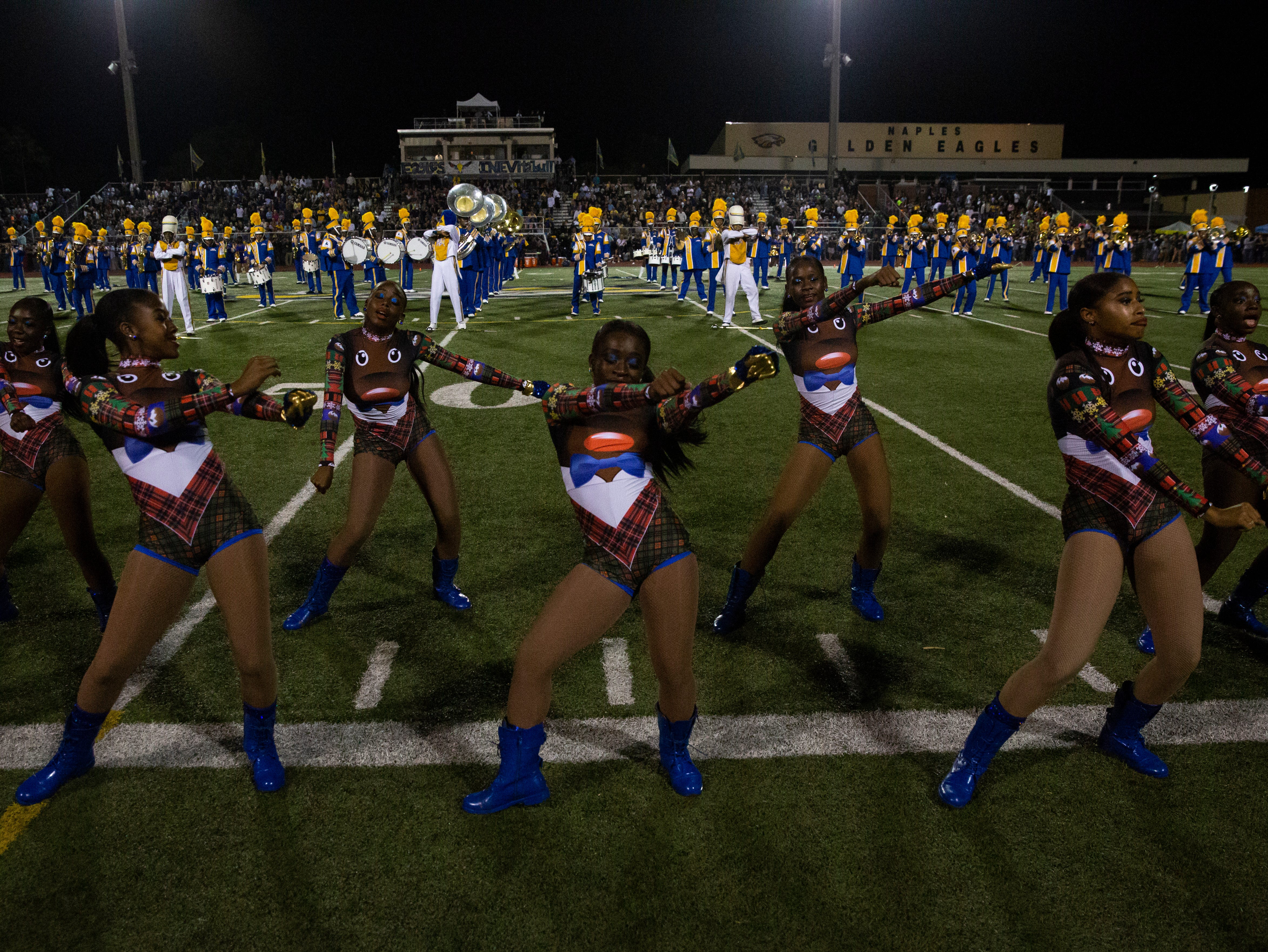 The Miami Northwestern Senior High cheerleaders perform during the Class 6A state semifinals game on Friday, November 30, 2018, at Naples High School in Naples.