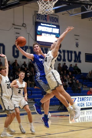 Brandon Noel, of Chillicothe, goes up for a shot in the lane against Granville's Will Skerbetz during the Cavaliers' 40-38 win in the first round of the Zanesville Tip-Off Classic on Friday at Winland Memorial Gymnasium.