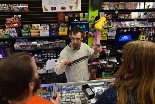 Sean Abline talks Magic: The Gathering with some customers at Level 1 Games in Pompton Plains on Friday November 30, 2018.