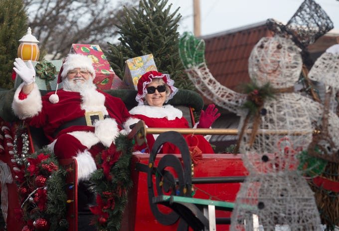 Santa Claus and Mrs. Claus make their way down Lafayette Avenue during the 33rd Annual Santa Parade in Hawthorne on Saturday, Dec. 1, 2018.