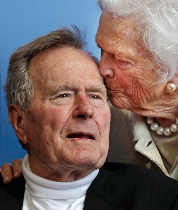 In this June 12, 2012 file photo, former President George H.W. Bush, and his wife, former first lady Barbara Bush, arrive for the premiere of HBO's documentary on his life near the family compound in Kennebunkport, Maine. Bush has died at age 94. Family spokesman Jim McGrath said Bush died shortly after 10 p.m. Friday, Nov. 30, 2018, about seven months after the death of his wife.