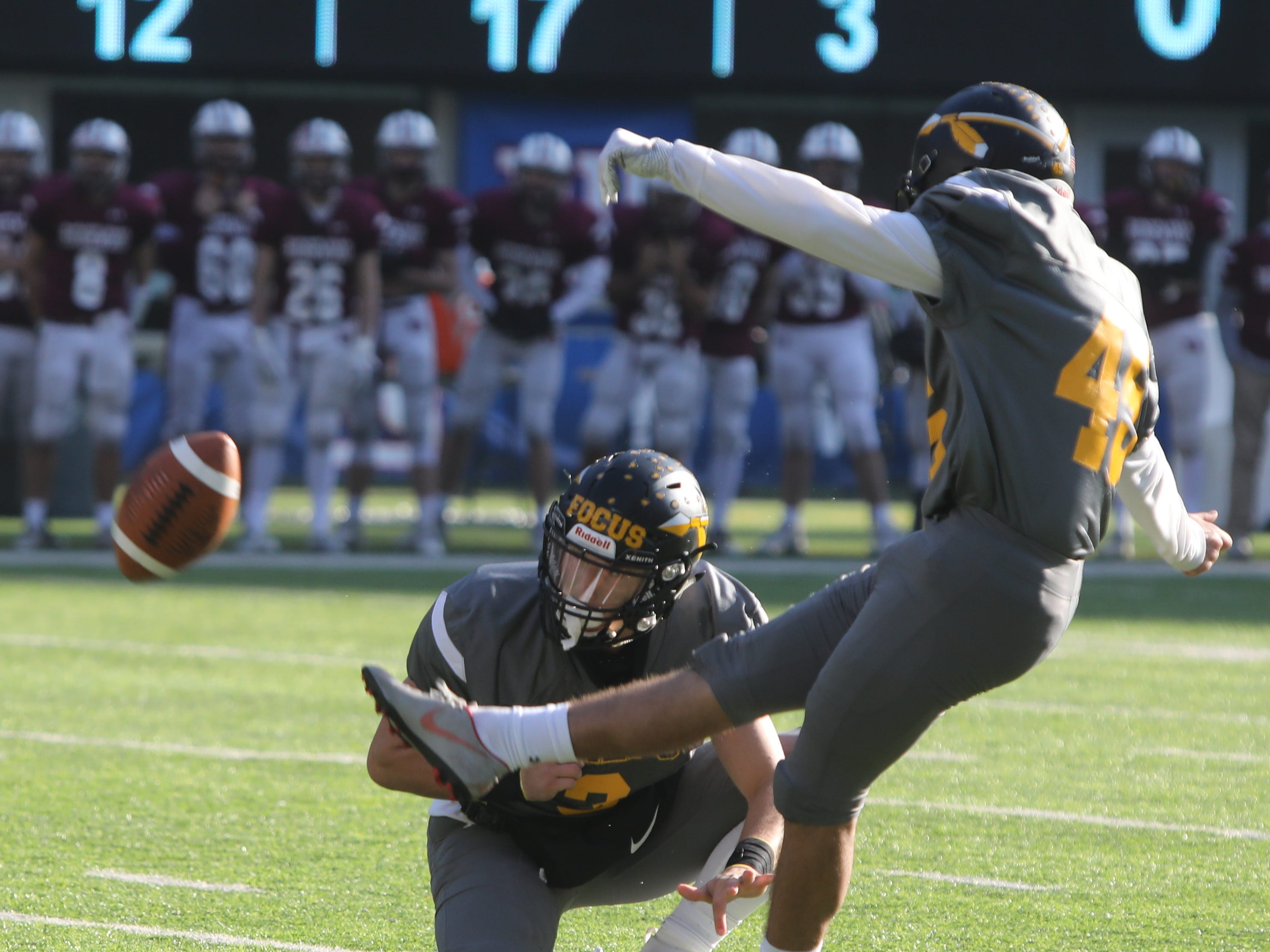 Robert Konya of Piscataway kicks a 34 yard field goal in the first quarter to open the scoring for the Chiefs.