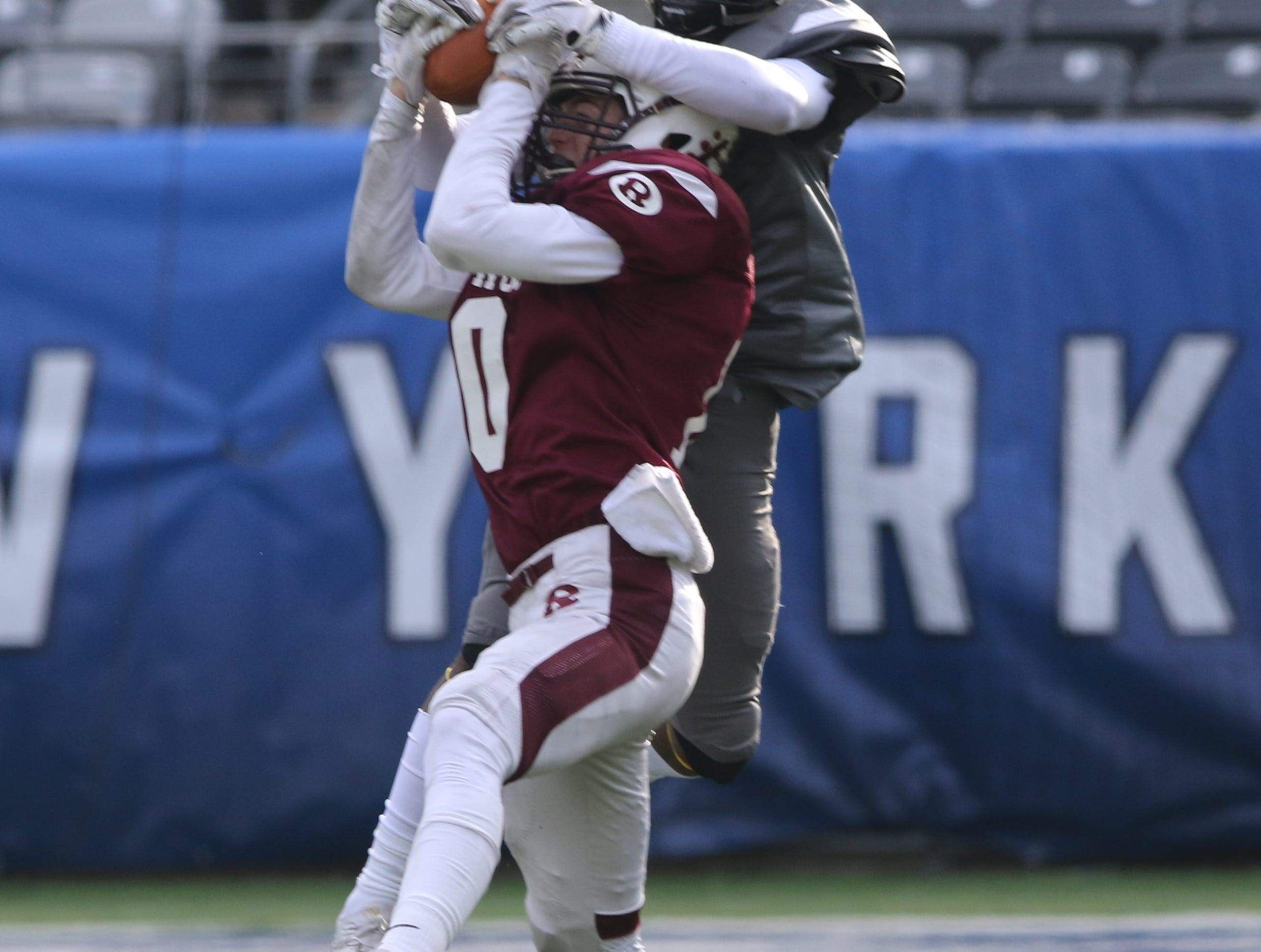 Gavin Peene of Ridgewood seems to come up with this interception but the ball is taken away by Lord James of Piscataway in the second half.