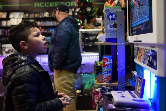 Justin Neufeld - eight from Pompton Plains concentrates as he plays a video game at Level 1 Games in Pompton Plains on Friday November 30, 2018.