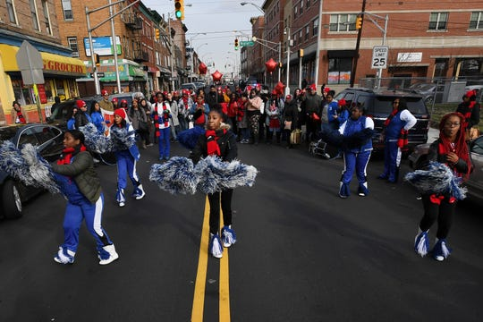 Cheerleaders from Lincoln High School perform during the march.