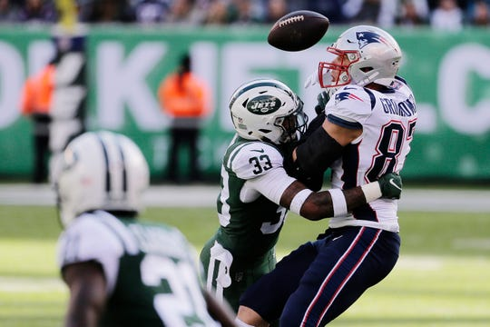 New York Jets strong safety Jamal Adams (33) breaks up a pass to New England Patriots' Rob Gronkowski (87) during the first half of an NFL football game Sunday, Nov. 25, 2018, in East Rutherford, N.J.