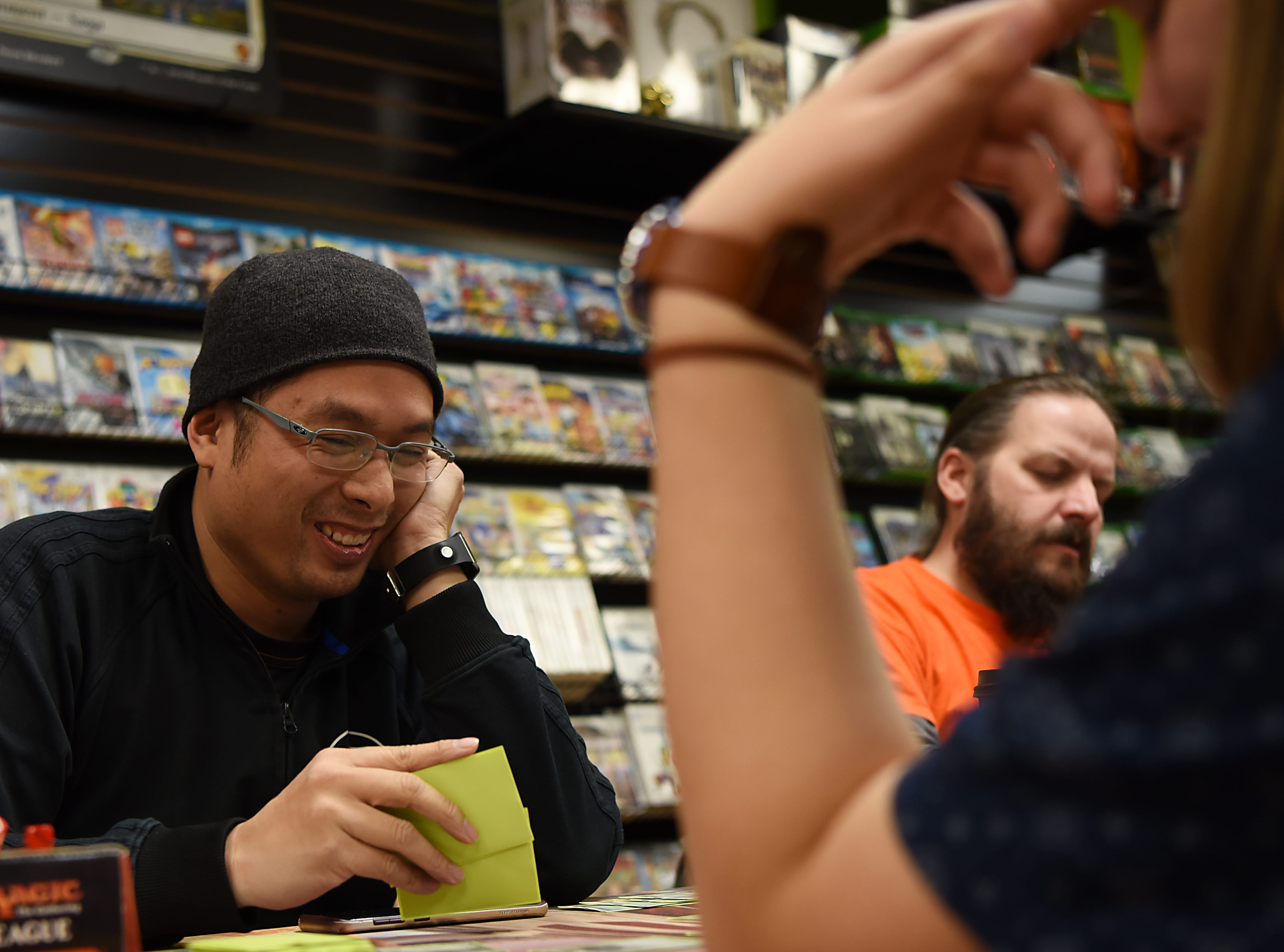 (From left) R.J. Moises from Clifton, Ian Dampman from Pompton Lakes and Isaac Dampman from Pompton Lakes play Magic: The Gathering at Level 1 Games in Pompton Plains on Friday November 30, 2018.