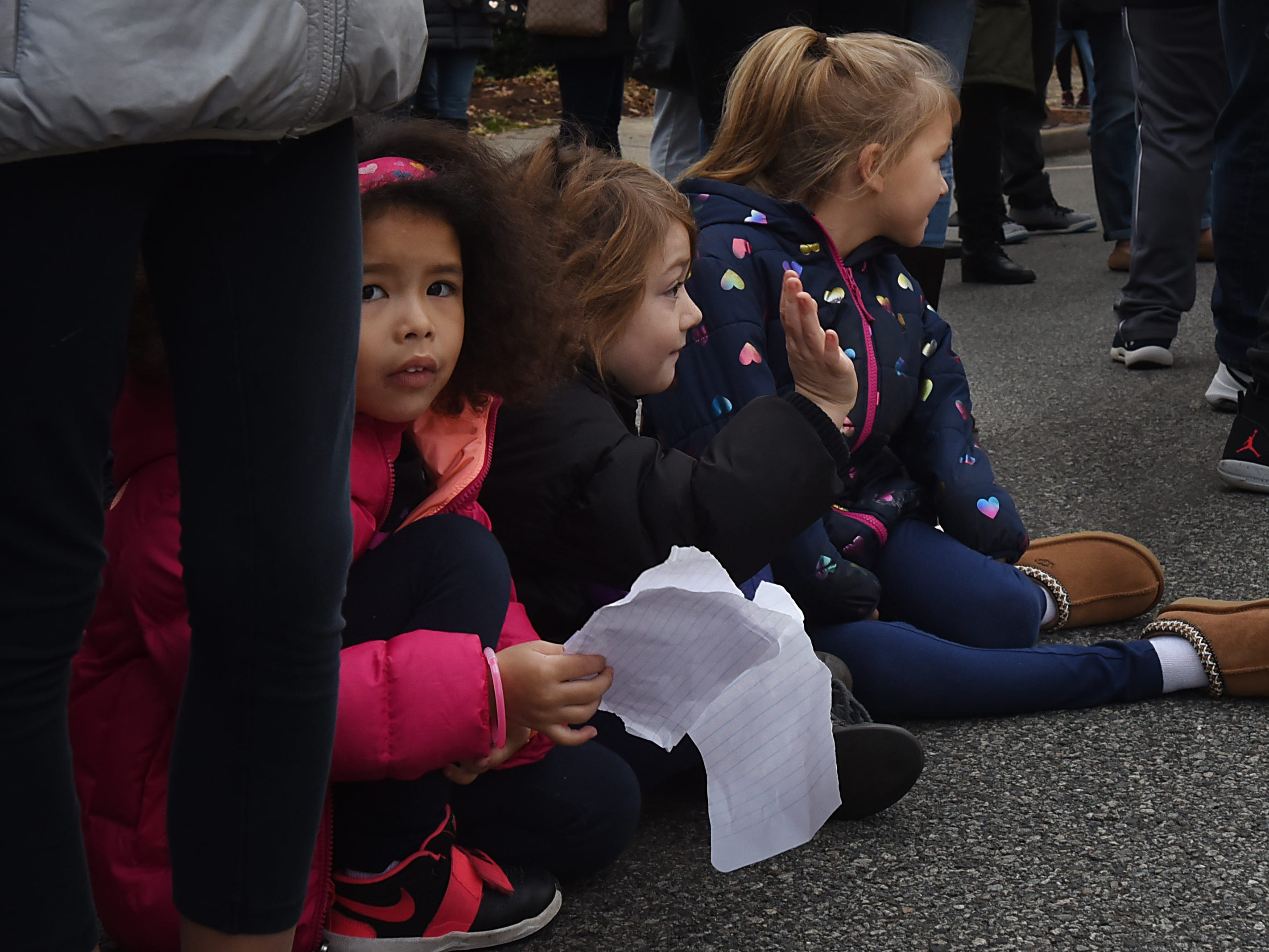 Children sit along the parade route at the Rutherford Football parade in Rutherford on Saturday December 1, 2018.