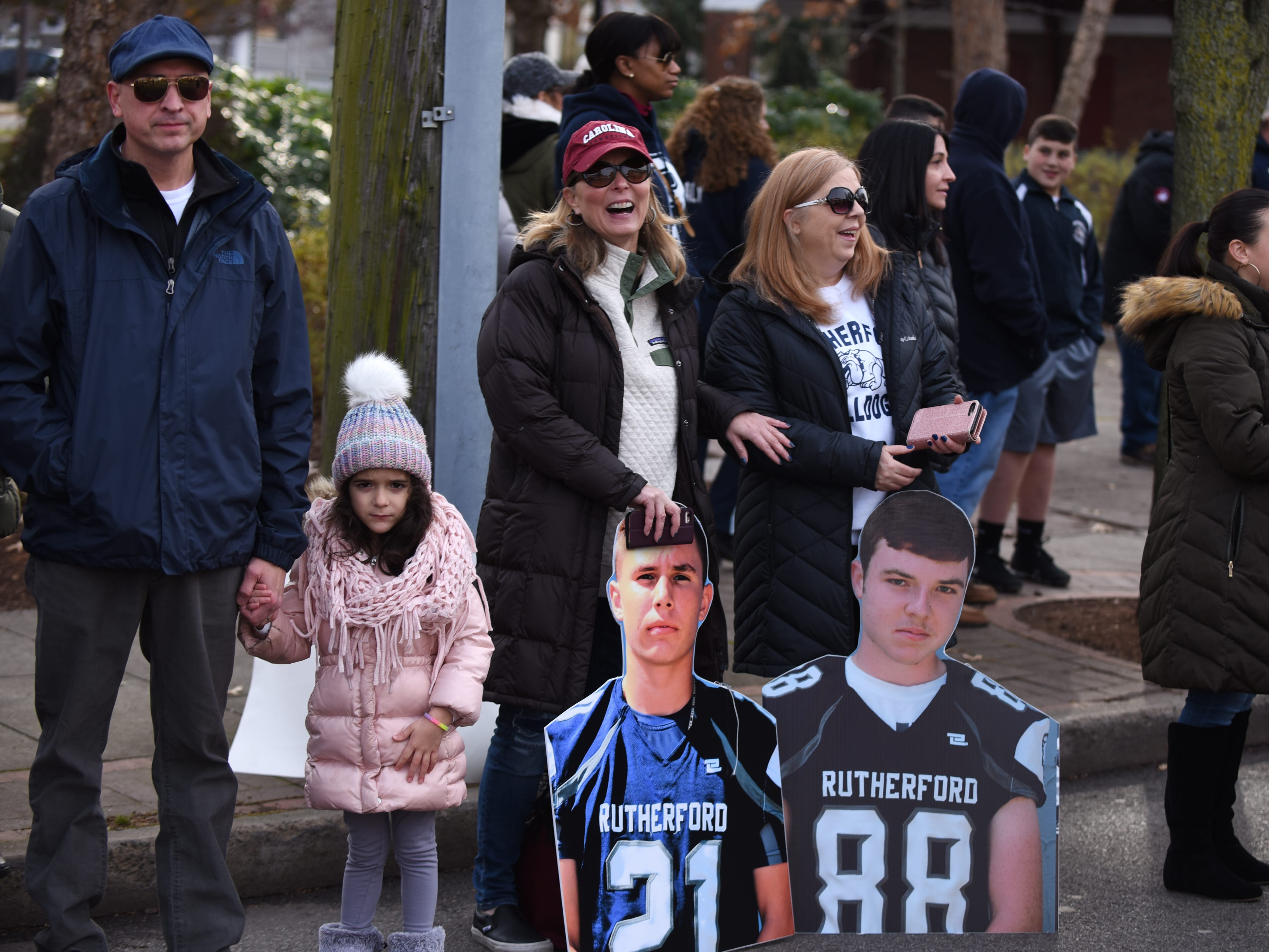 People cheer on the Rutherford Football parade in Rutherford on Saturday December 1, 2018.