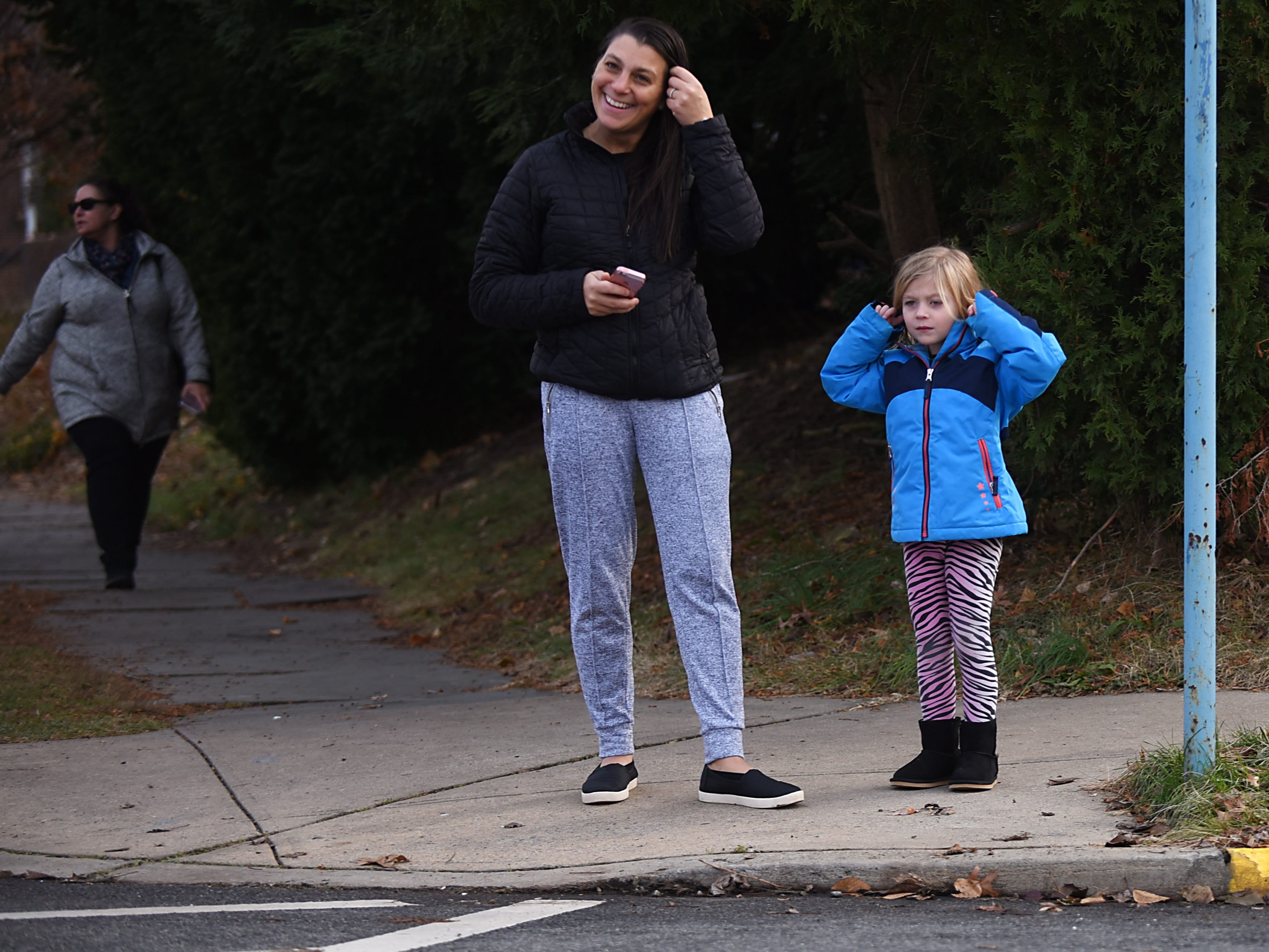 A little girl covers her ears during the Rutherford Football parade in Rutherford on Saturday December 1, 2018.