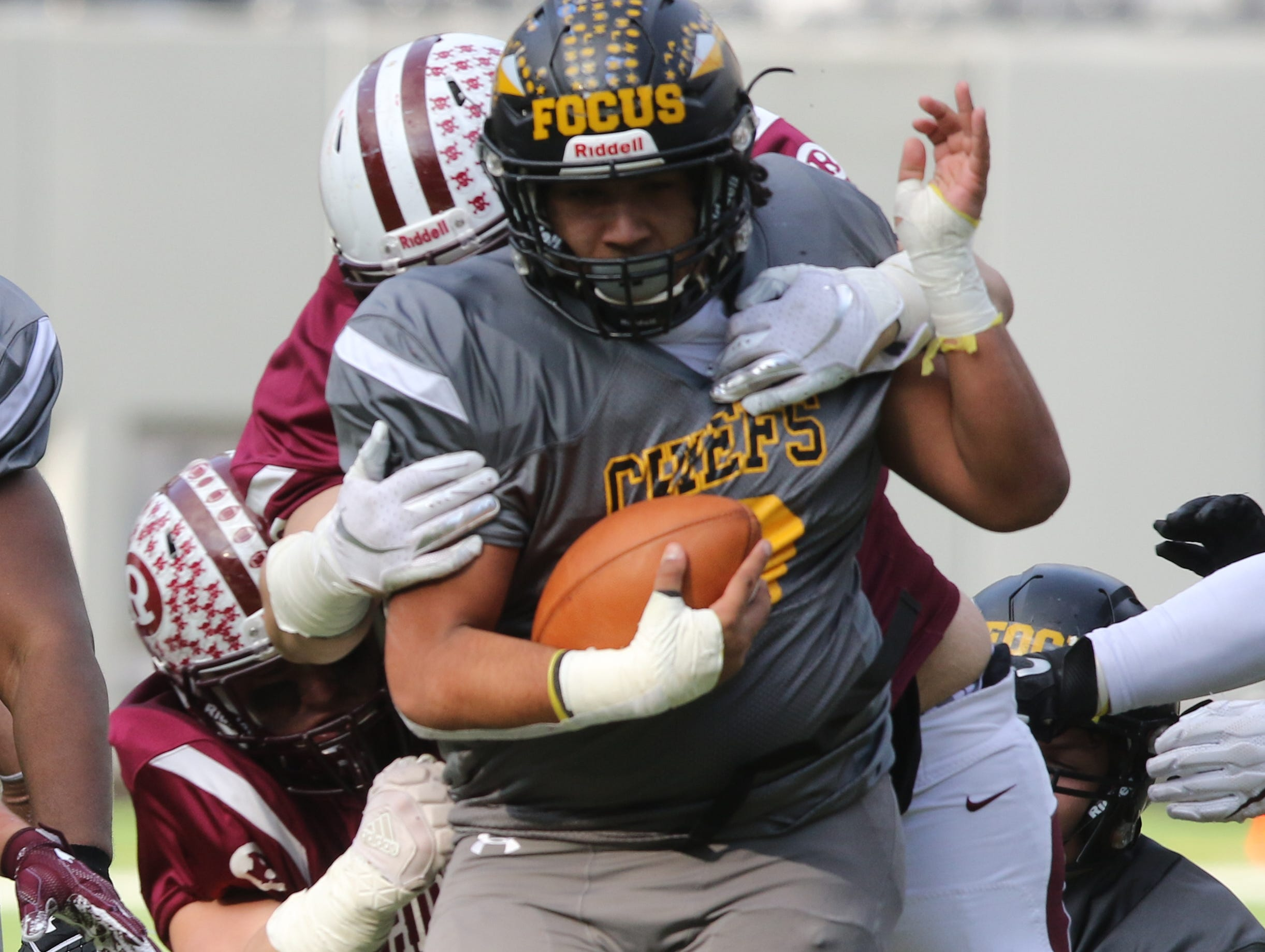 Daniel Lopez of Piscataway is tackled by the Ridgewood defense in the first half.