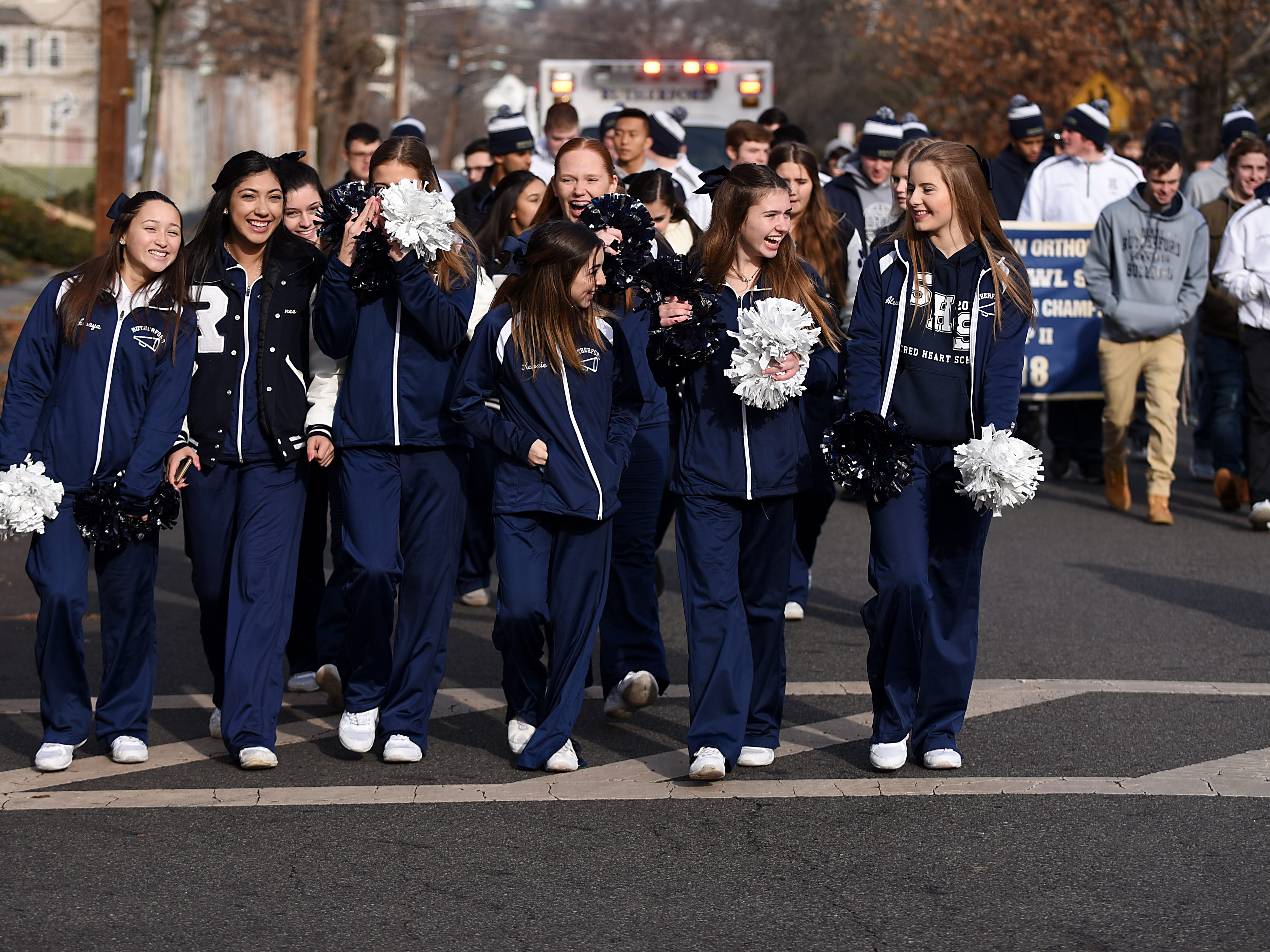 Cheerleaders march in the Rutherford Football parade in Rutherford on Saturday December 1, 2018.