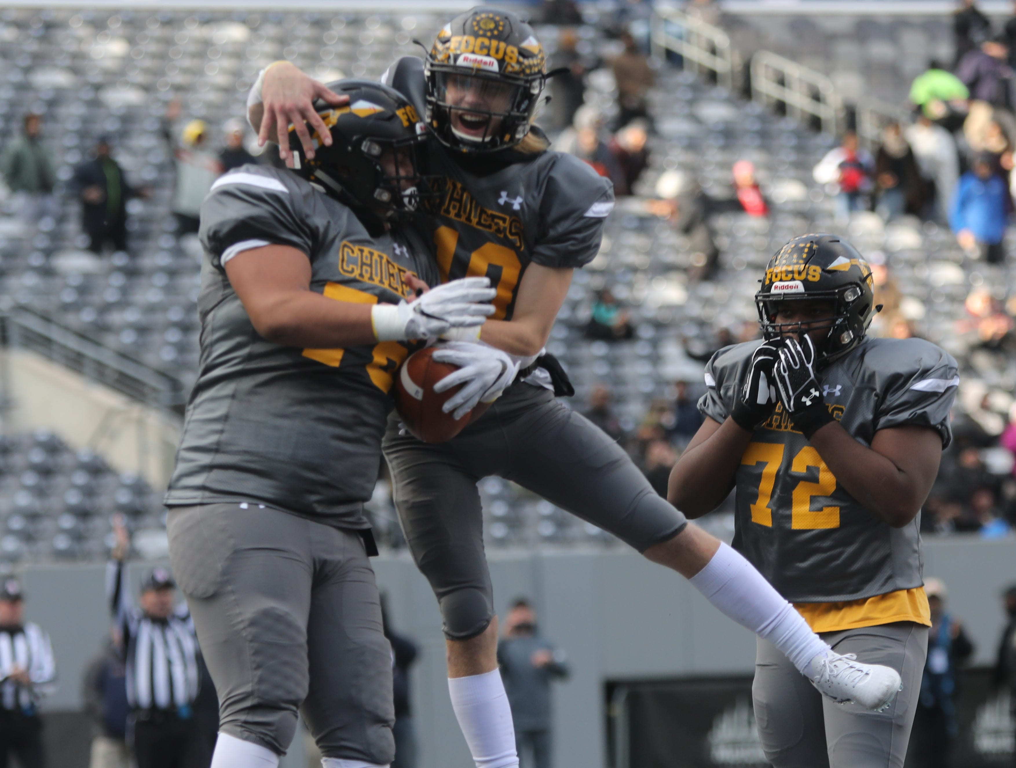 Offensive lineman Jordan Martell scores a second quarter TD on a recovery fumble and celebrates with team mate Joseph Hatcher.