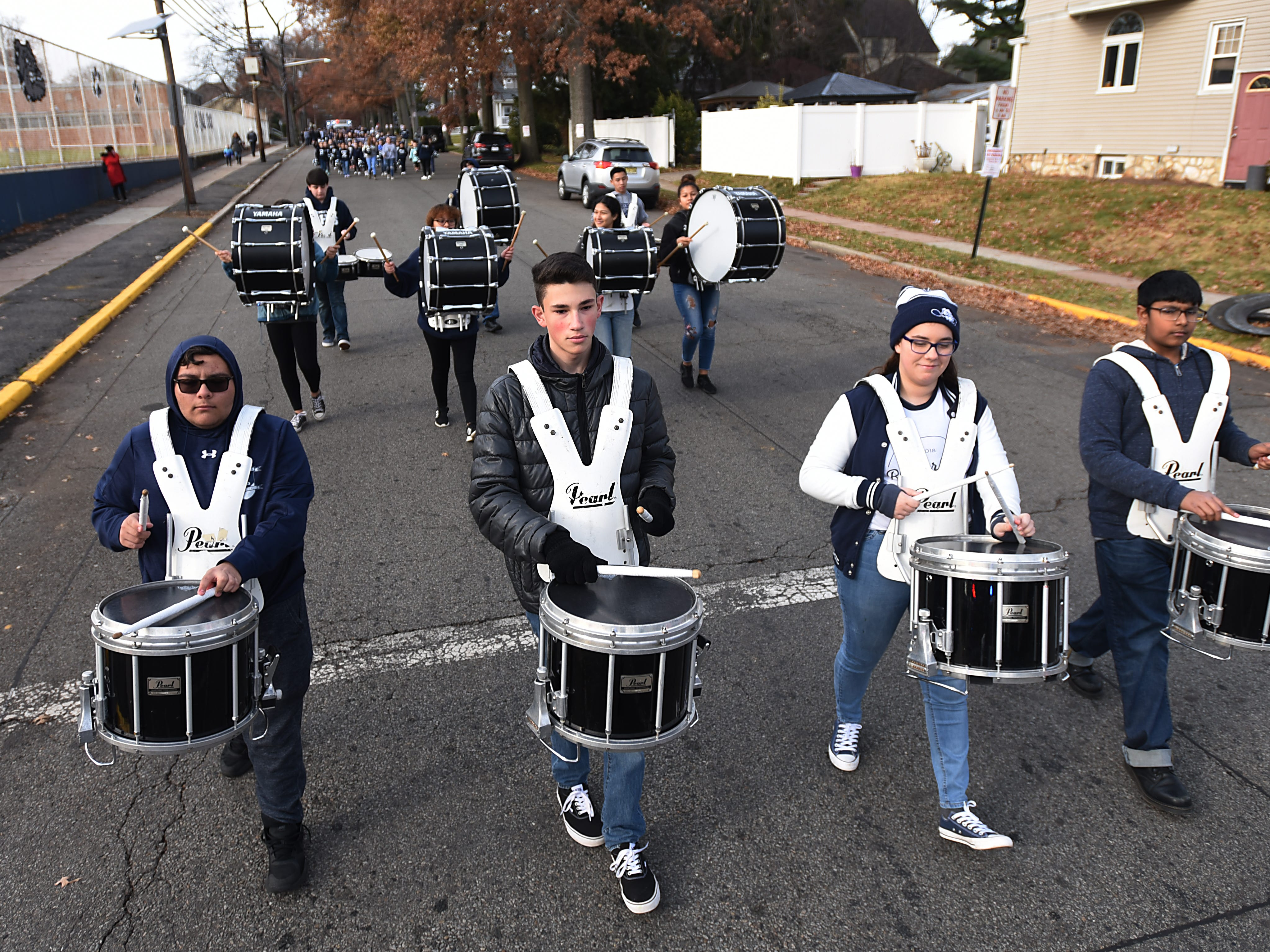 The drum line leads the Rutherford Football parade in Rutherford on Saturday December 1, 2018.