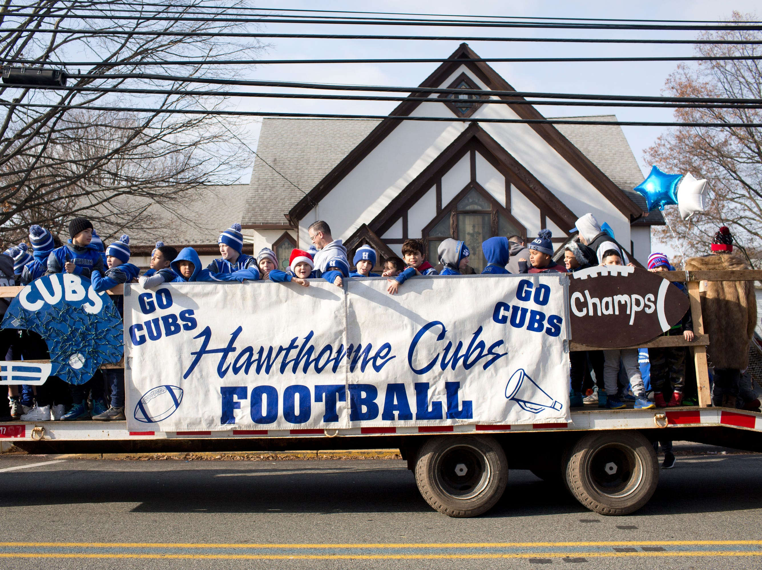 The Hawthorne Cubs Football float makes its way down Lafayette Avenue during the 33rd Annual Santa Parade in Hawthorne on Saturday, Dec. 1, 2018.
