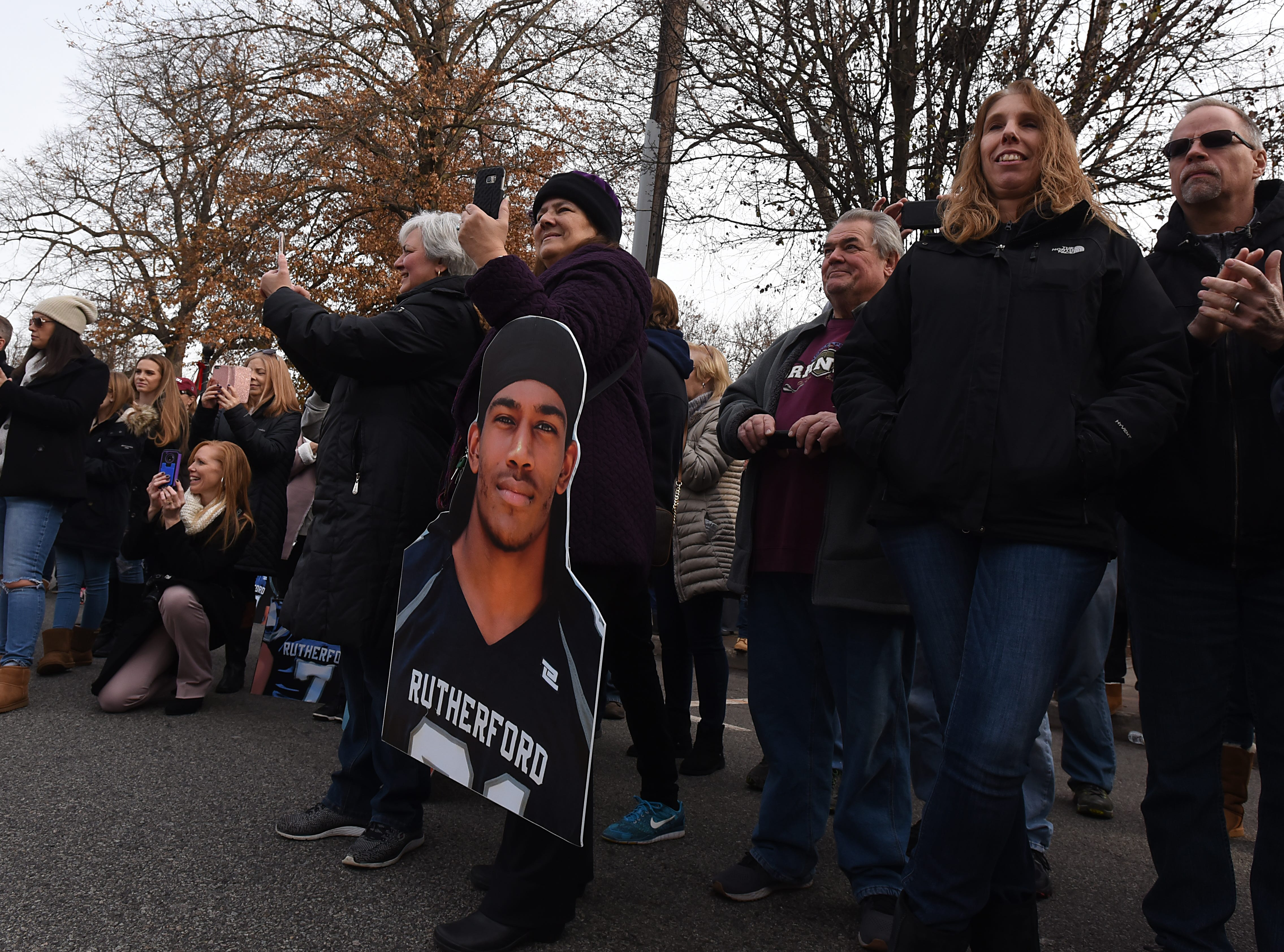 People cheer along the parade route at the Rutherford Football parade in Rutherford on Saturday December 1, 2018.