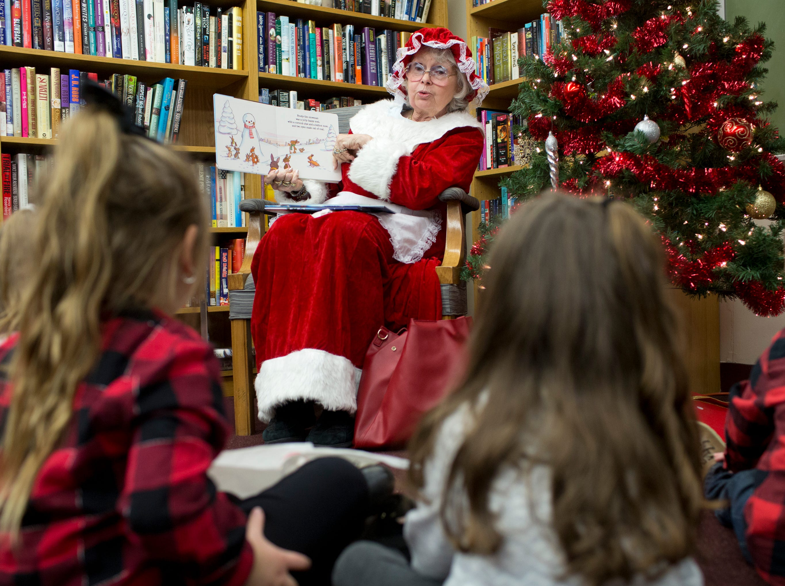 Mrs. Claus reads children books at Louis Bay 2nd Library after the 33rd Annual Santa Parade in Hawthorne on Saturday, Dec. 1, 2018.