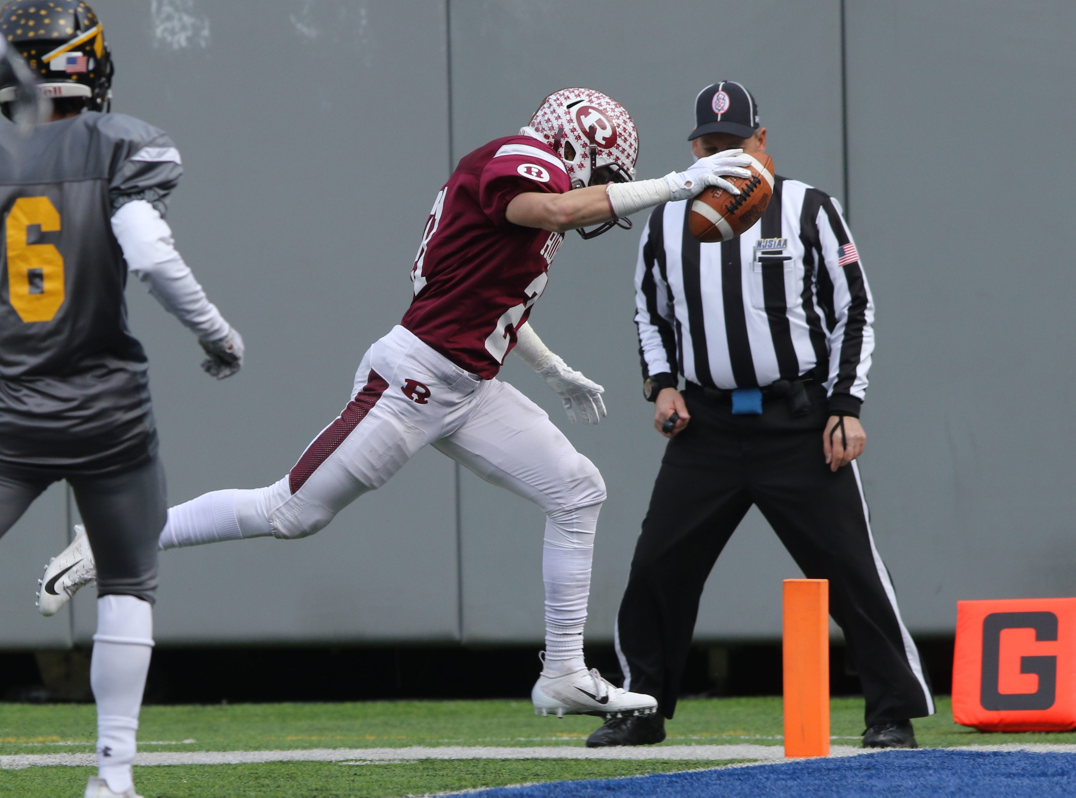 Will McDermott of Ridgewood scores a second two point conversion for the Maroons.