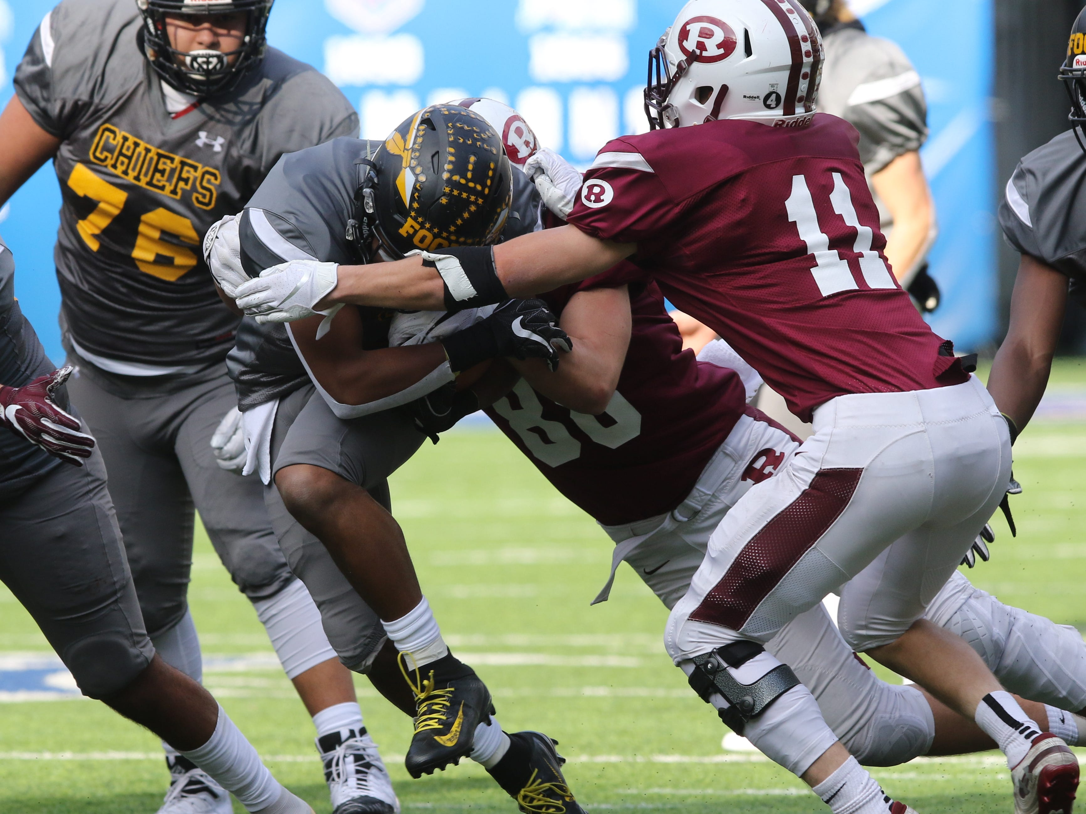 Nasir Best of Piscataway is tackled by Harrison Roberts of Ridgewood in the first half.