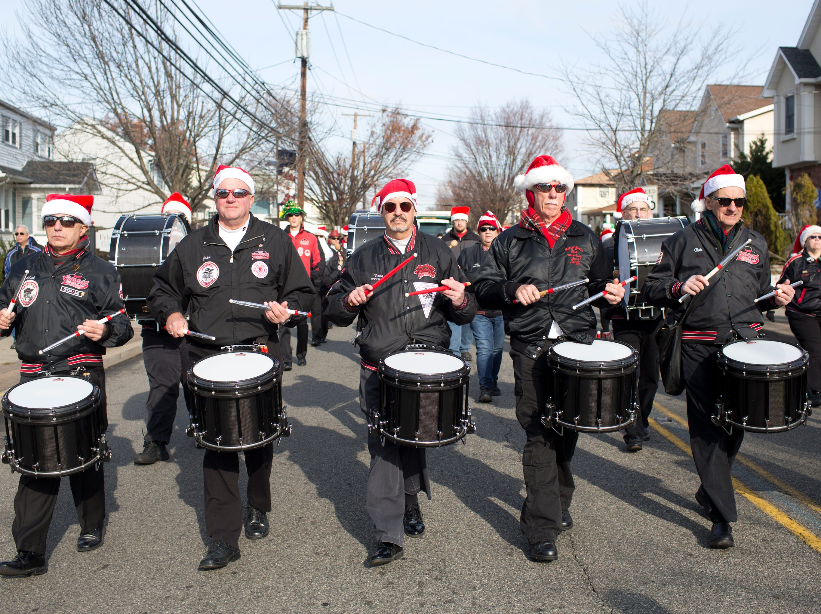 The Hawthorne Caballeros Alumni Drum and Bugle Corps make their way down Lafayette Avenue during the 33rd Annual Santa Parade in Hawthorne on Saturday, Dec. 1, 2018.