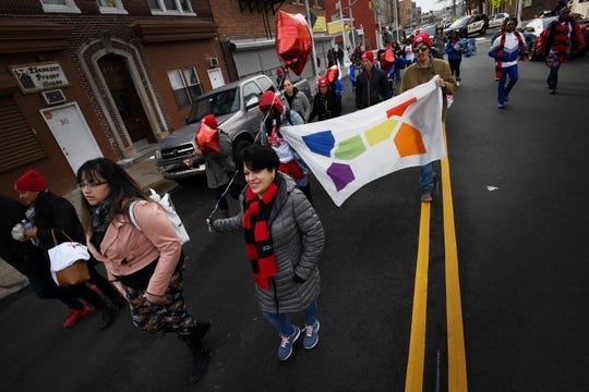 About 100 people participated in the march, co-organized by the city and RWJBarnabas Health.