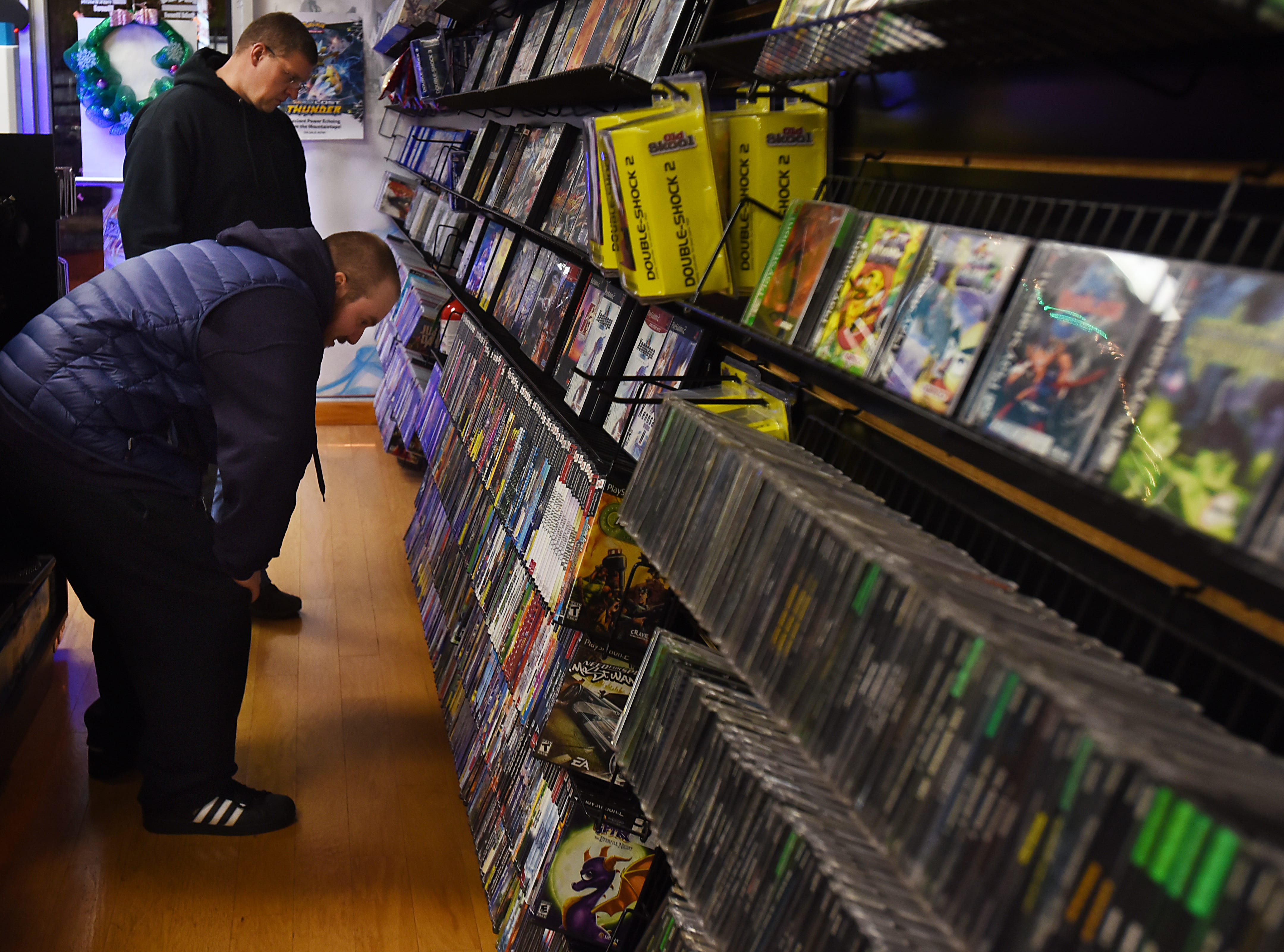 Customers browse the racks at Level 1 Games in Pompton Plains on Friday November 30, 2018.