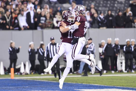 Wayne Hills football vs. Phillipsburg in North Group 4 Bowl Game at MetLife Stadium in East Rutherford on Friday, November 30, 2018. WH #11 Jaaron Hayek celebrates after scoring a touchdown in the first quarter with #9 Tom Sharkey.