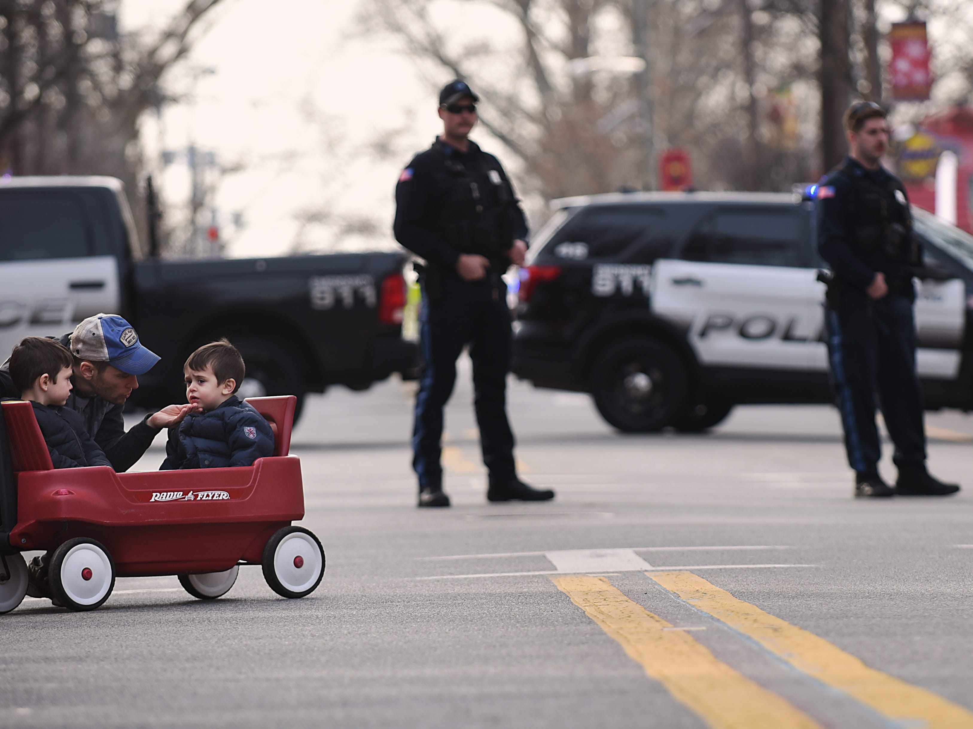 Two children arrive in a red wagon during the Rutherford Football parade in Rutherford on Saturday December 1, 2018.