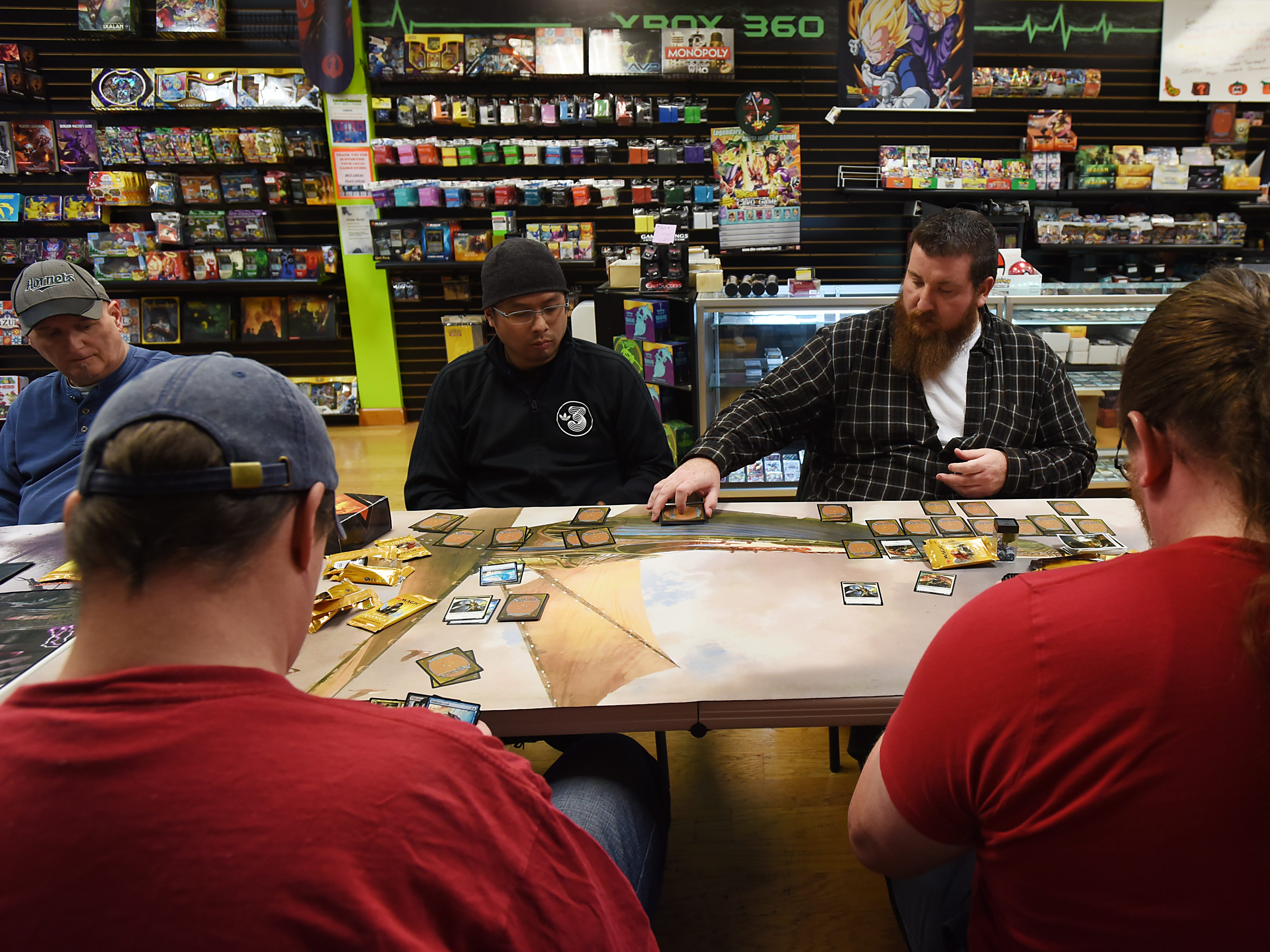 Customers play Magic: The Gathering at Level 1 Games in Pompton Plains on Friday November 30, 2018.
