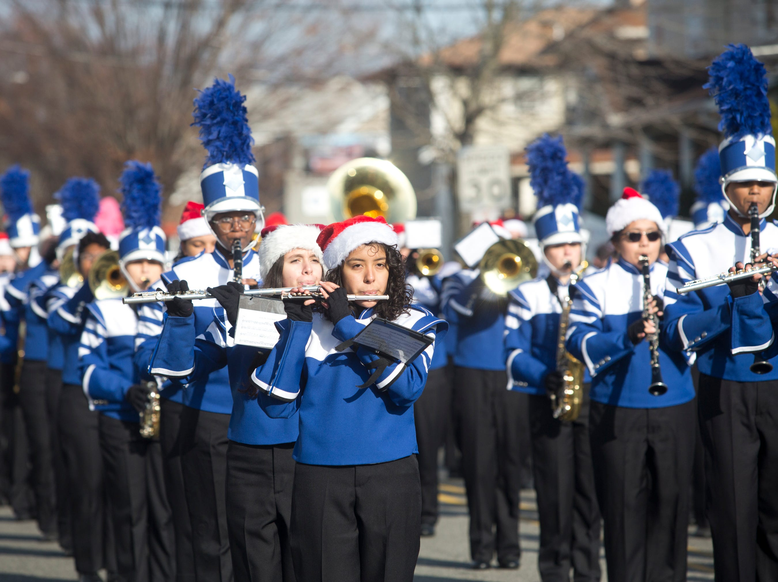 Britney Sanchez, an 11th grader at Passaic County Technical Institute, plays the piccolo during the 33rd Annual Santa Parade in Hawthorne on Saturday, Dec. 1, 2018.