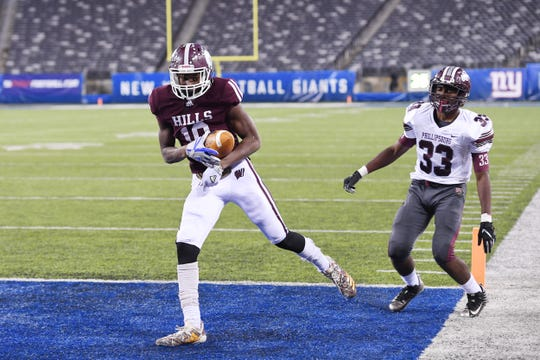 Wayne Hills' Charles Njoku scores a touchdown after making a catch in the third quarter of Wayne Hills' game against Phillipsburg in North Group 4 Bowl Game at MetLife Stadium in East Rutherford on Friday, November 30, 2018.