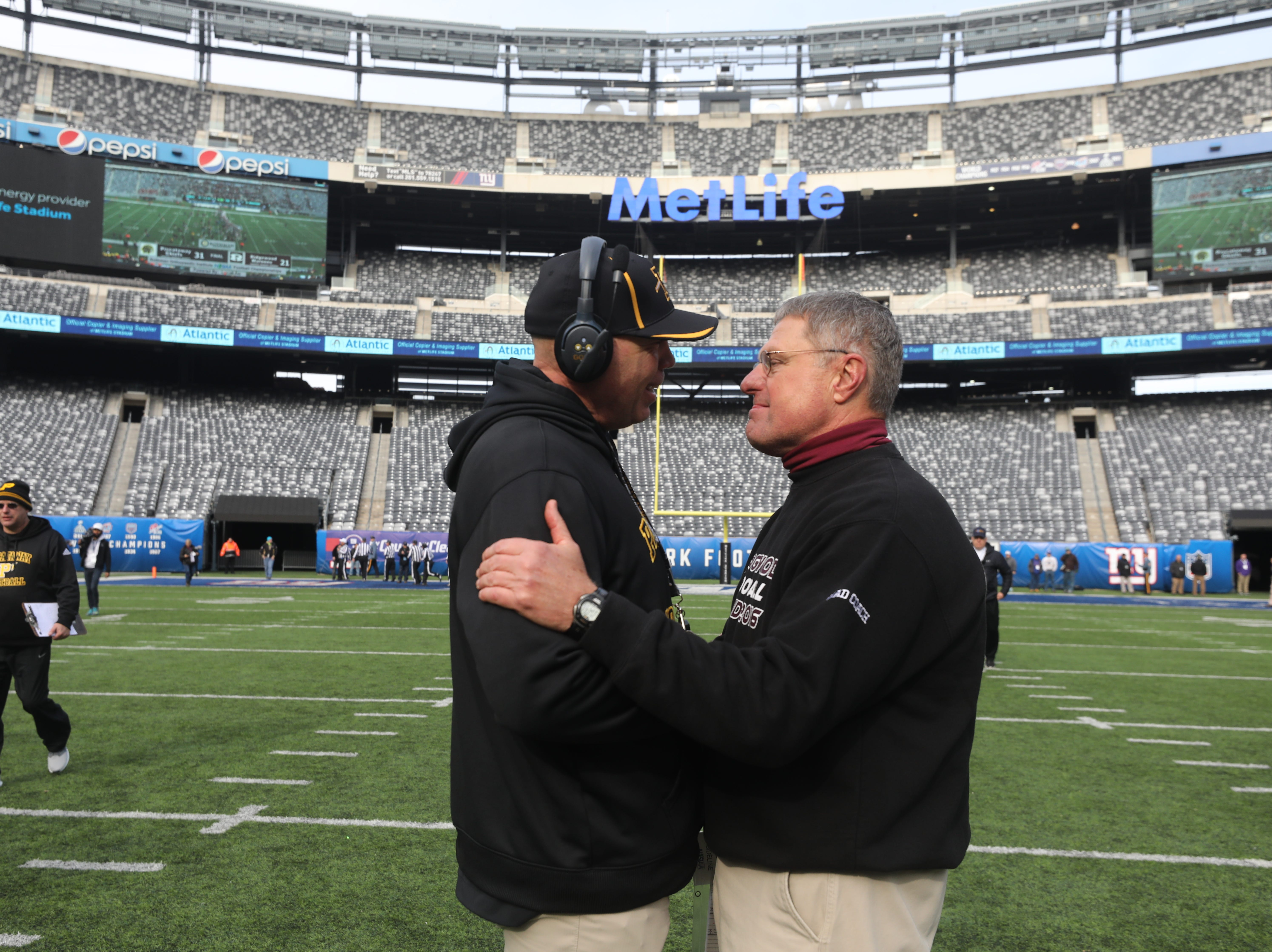 Head coaches Daniel Higgins of Piscataway and Chuck Johnson of Ridgewood get together at the end of the game.