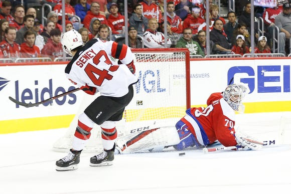 Nov 30, 2018; Washington, DC, USA; Washington Capitals goaltender Braden Holtby (70) makes a save on New Jersey Devils left wing Brett Seney (43) in the second period at Capital One Arena.